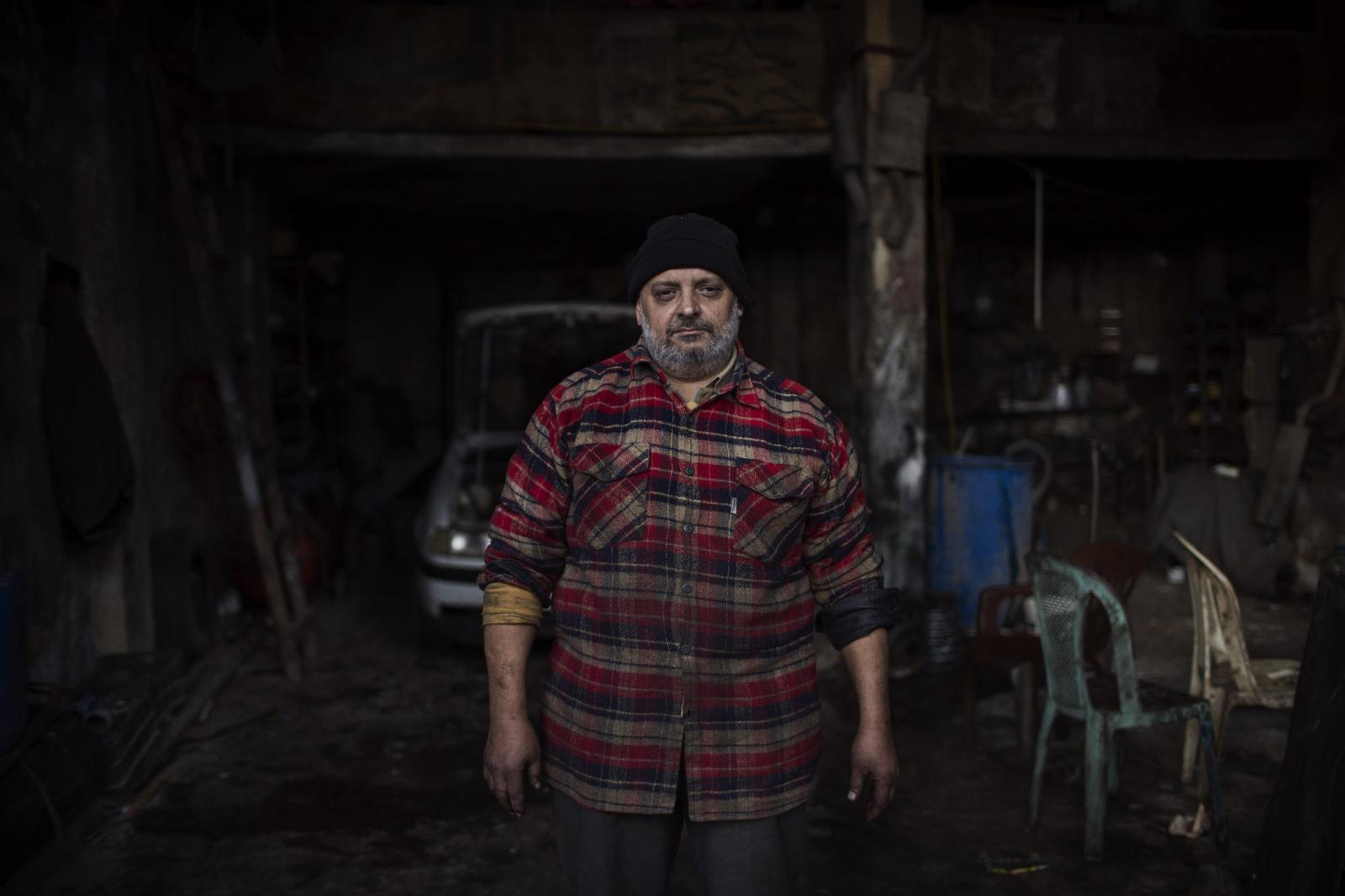 Issam al Moubayed, car mechanic. He's had two heart surgeries but has to work, earning around 15000 LL a day. Bab al-Tabbaneh, Tripoli. Lebanon. December 11th, 2019. Diego Ibarra Sánchez for CNN