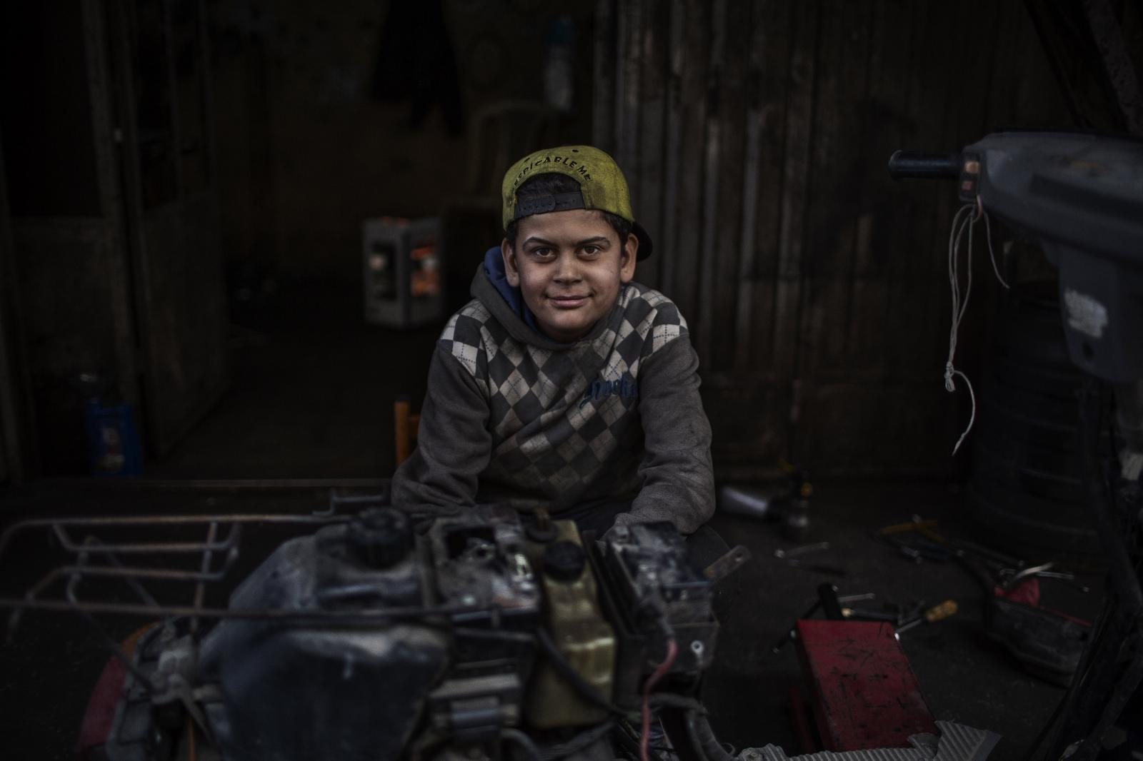 """Abdel Hayy Ayoubi, 15 years old. """"I'd like to go to school but I'd also not like to go to school."""" He worked with car mechanics before becoming a motorcycle fixer. His father is a garbage collector. Abdel Hayy went to school for just two years. Part of growing illiteracy. Tripoli. Lebanon. December 11th, 2019. Diego Ibarra Sánchez for CNN"""