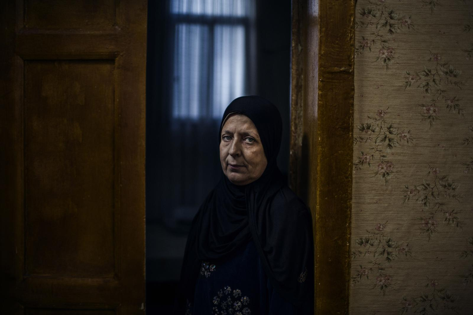 Sahar Khaja, 58, lives in a house al-Mina where the ceiling is falling apart. Some 15 members of her family live in a tiny three-bedroom house. Her nephew's family just moved in after their neighbor's roof collapsed. December 11th, 2019. Diego Ibarra Sánchez for CNN