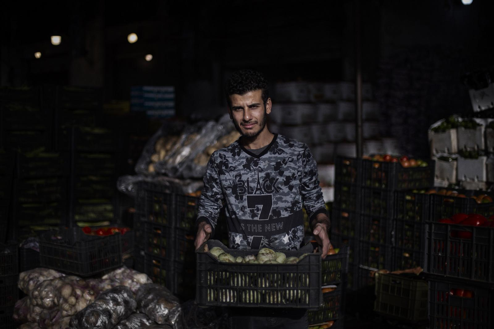 Ali Deeb, 26, vegetable worker. I'm against the revolution. It makes me tired and the road closures get in the way of my work. Bab al-Tabbaneh, Tripoli. Lebanon. December 11th, 2019. Diego Ibarra Sánchez for CNN
