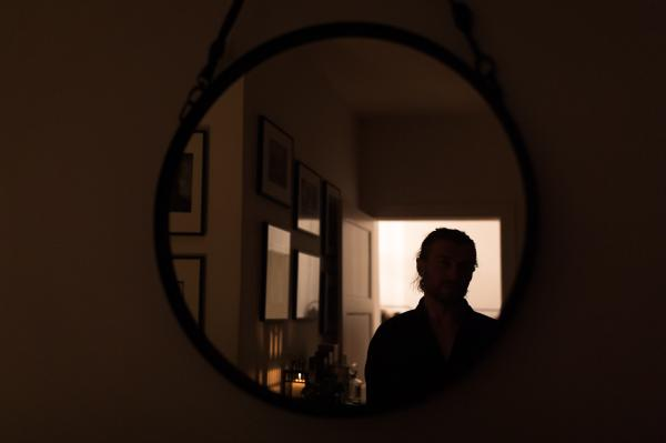 Looking at the man in the mirror. Berlin, Germany, March 24, 2020.
