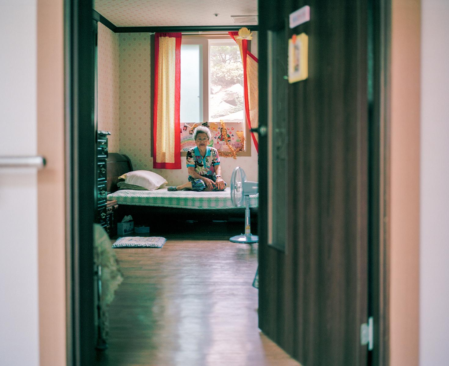Kim Soon Ok Halmoni in her room, House of Sharing, Gwangju, South Korea, 2010