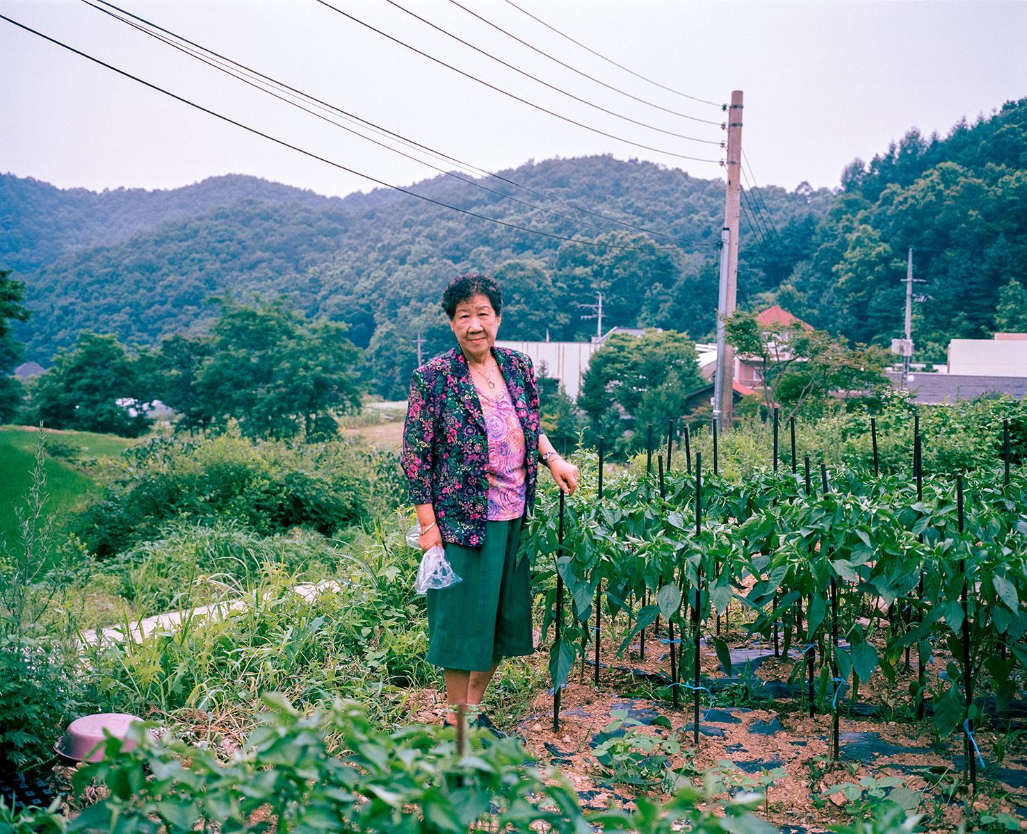 Kang Il Chul Halmoni in her garden, House of Sharing, Gwangju, South Korea, 2010