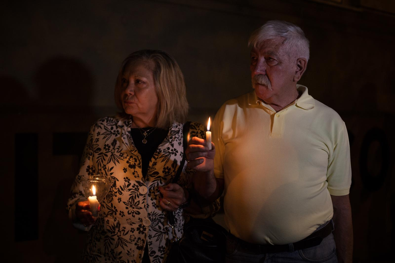 A couple holds a candle at the vigil for the victims of Manhattan terrorist attack. Rosario, Argentina, November 1st 2017, Erica Canepa for The Wall Street Journal