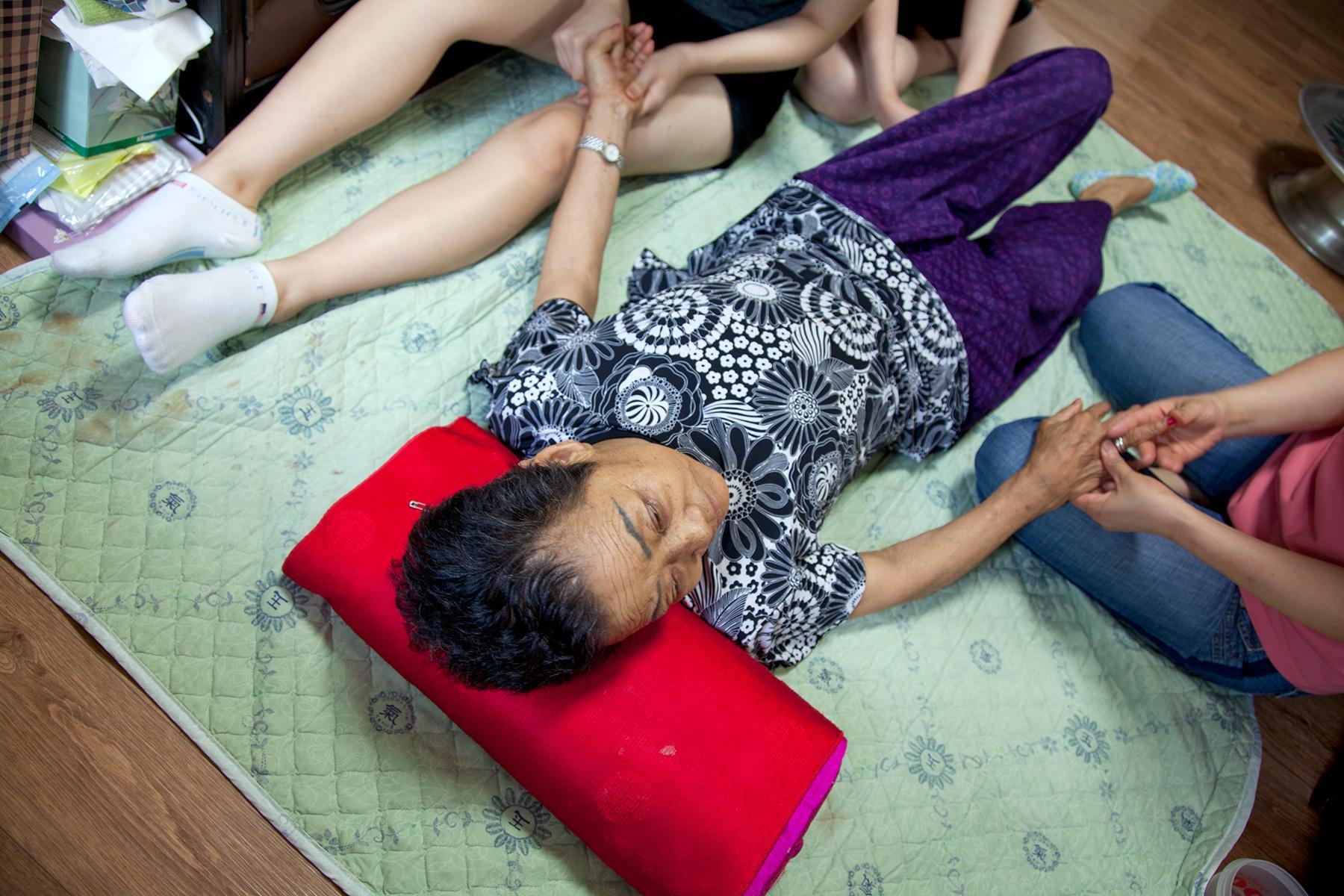 Kim Hwa Seon Halmoni with visitors, House of Sharing, Gwangju, South Korea, 2010