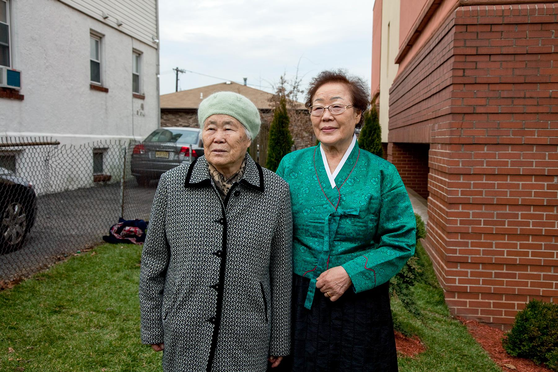 Lee Ok Seon Halmoni and Lee Yong Soo Halmoni posing for photos after the ceremony, Palisades Park, NJ, 2011