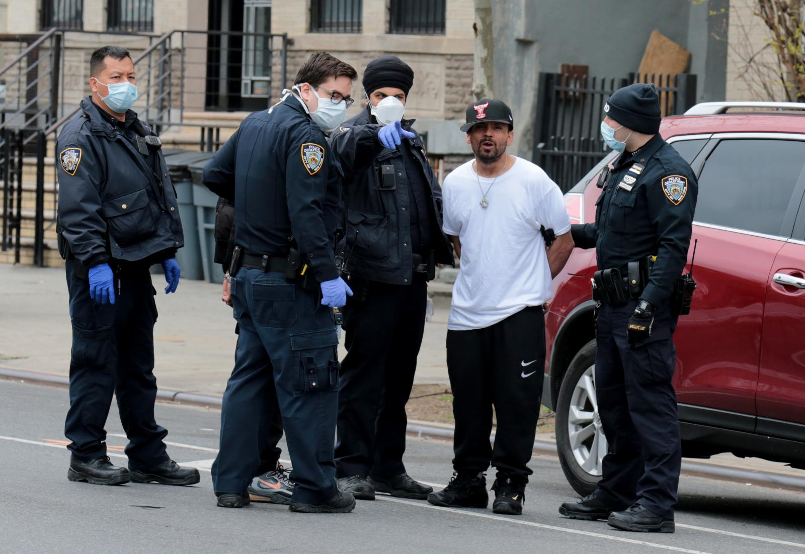 New York - April 21, 2020 -- NYPD officers from the 79 and 81st Precincts arrest a unidentified suspect accused of firing several shots on 641 Vernon Avenue and fleeing. The suspects were arrested on Lewis and Myrtle Avenues. NYPD Officers during arrests can not practice social distancing during the coronavirus pandemic outbreak. (Luiz C. Ribeiro for New York Daily News)