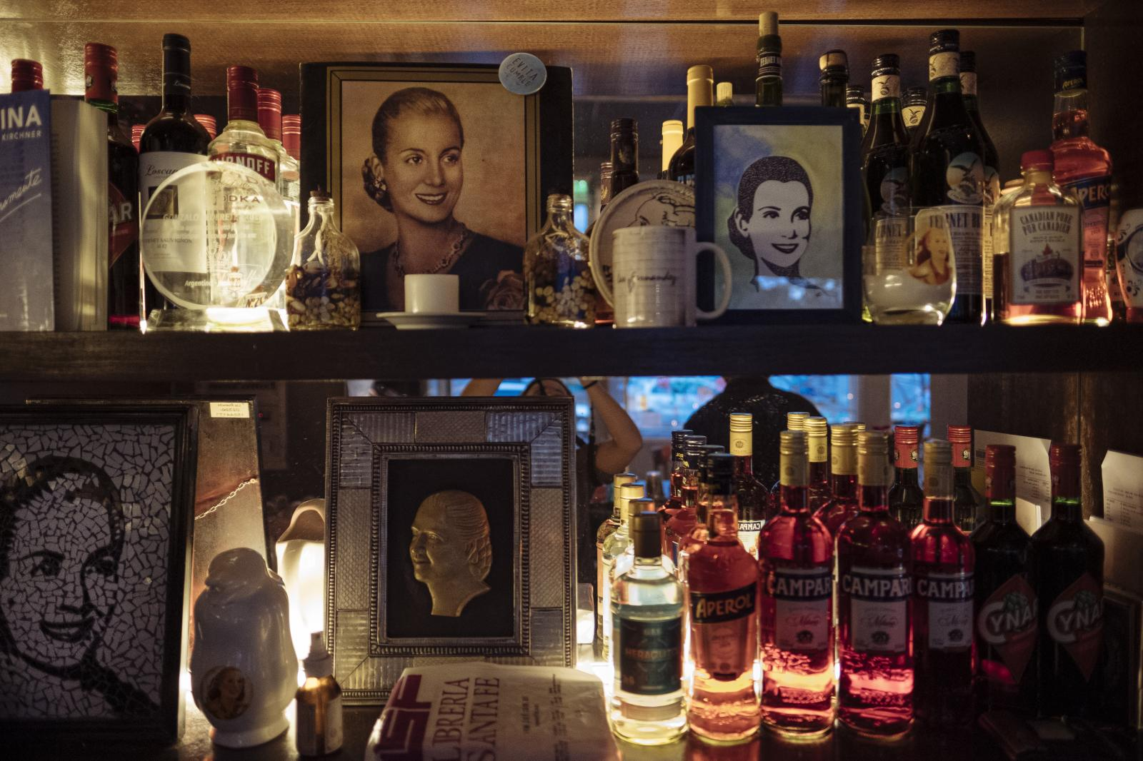 Evita's portraits stand on wine shelves at Santa Evita Restaurant, Buenos Aires, Argentina, on Wednesday, Dec. 4, 2019.
