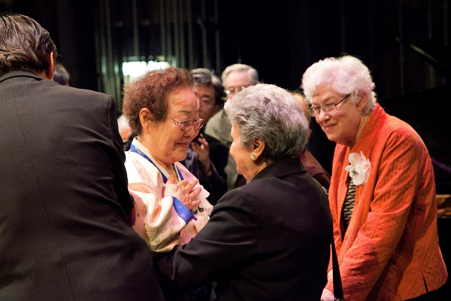 Lee Yong Soo Halmoni and Ethel Katz embracing, Kupferburg Holocaust Center, Queens, NY, 2011