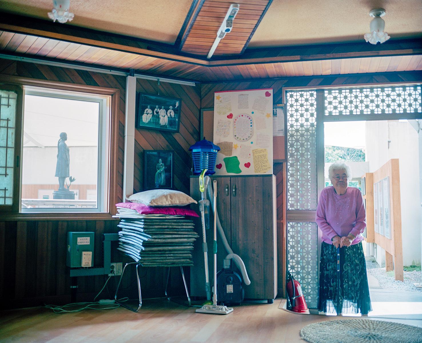 Lee Ok Seon Halmoni in the doorway, House of Sharing, Gwangju, South Korea, 2010