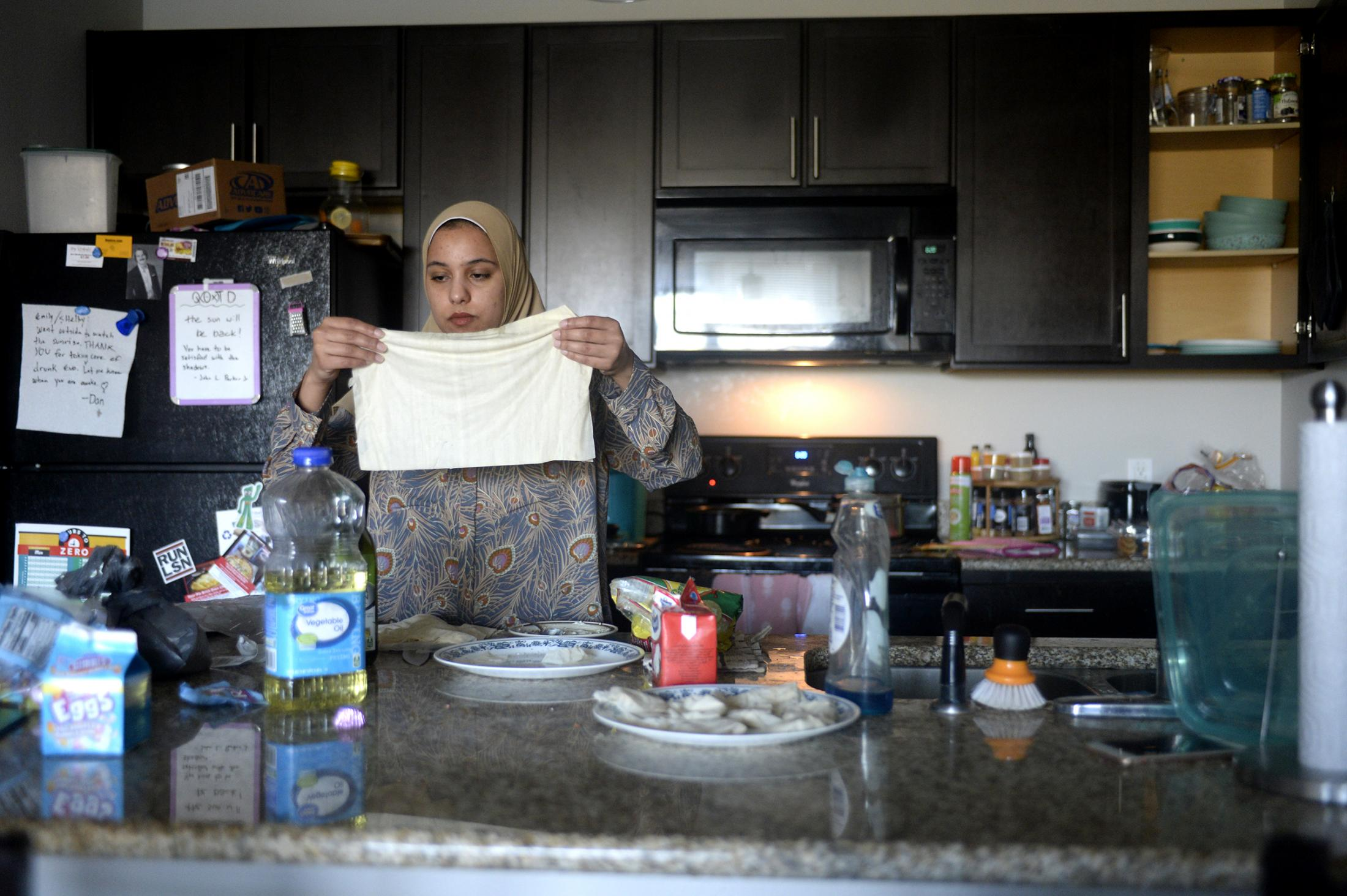 Sohaila Bakr spreads the dough to make samosas on Monday, April 20, 2020, in Columbia. Due to the COVID-19 situation, it's the first time Bakr is spending Ramadan alone. Normally she would go to the Islamic Center of Central Missouri to celebrate.