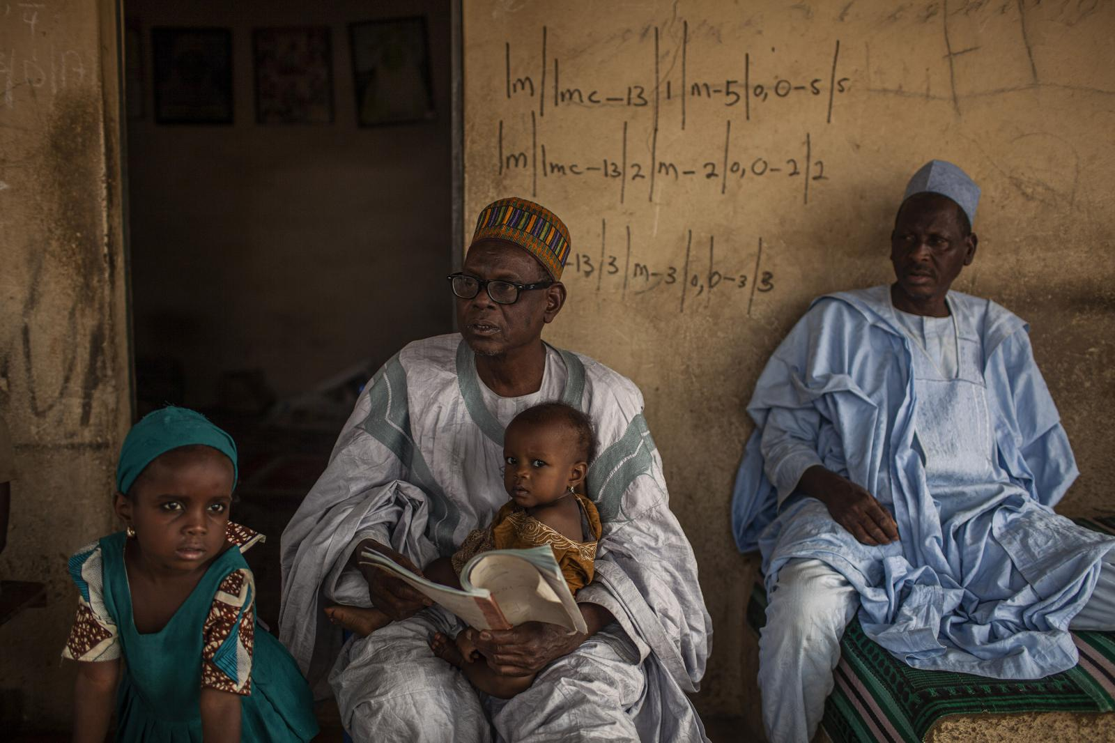 A nigerian family waits for the polio vaccinator team in Kano. Nigeria 2014. Nigeria is the last country in Africa to have witnessed a case of polio - in Borno state, in the north-east. Outside of Nigeria, the last case on the continent was in the Puntland region of Somalia, in 2014. Diego Ibarra Sánchez