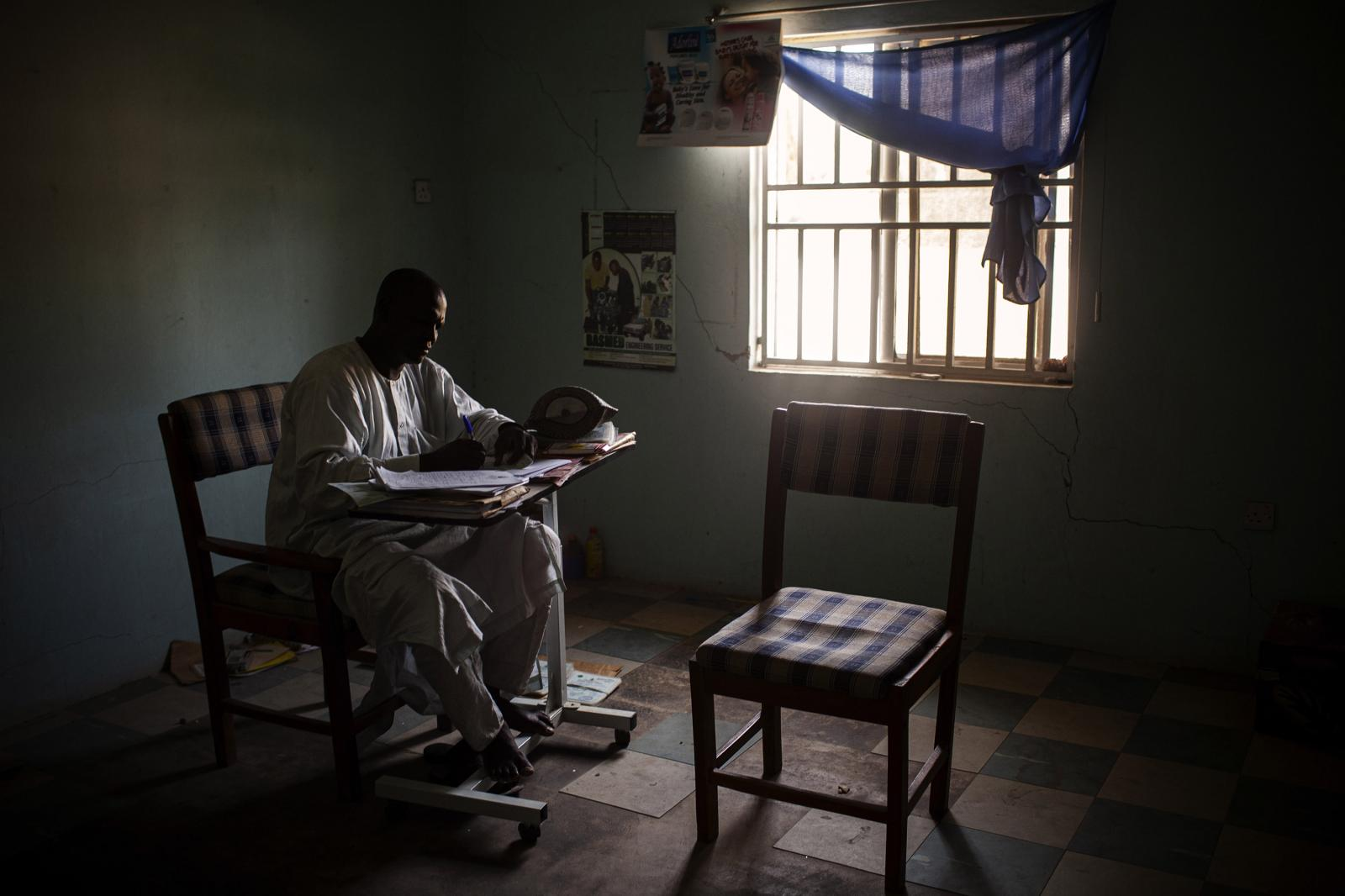 A health worker is seen inside a hospital in Maiduguri. Nigeria 2014. After ten years of conflict with Boko Haram in the northeast, Nigeria continues to contend with violence from the insurgency group and its breakout factions, as well as violent banditry, kidnappings, and killings by armed groups in other parts of the country. Diego Ibarra Sánchez