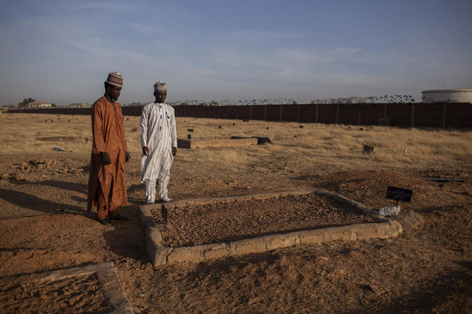 Relatives of a dead vaccinator killed by Boko Haram visit his tomb. Kano, Nigeria 2014.Boko Haram tried to stop Nigeria from eliminating polio. They failed. Inaccessible areas occupied by the ISIS-linked sect, have prevented the vaccination of as many as 66,000 children in the northern state of Borno. Diego Ibarra Sánchez