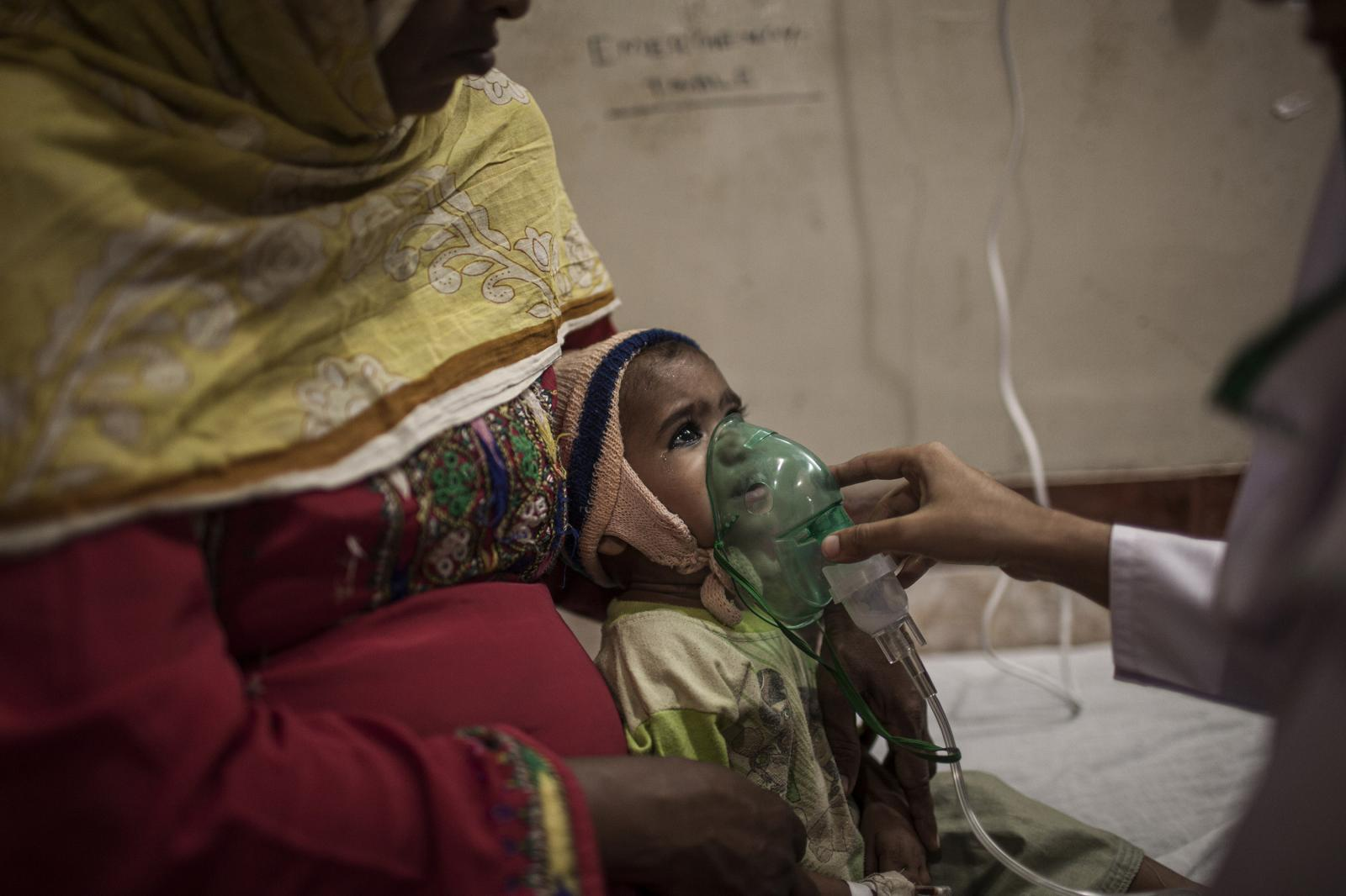 A child gets respiratory aid at the Functional Nutrition Center in Liaqat University of Medical Health Sciences in Hyderabad. 30% of children are affected by malnutrition. In all, it forms to increase the risk of disease and early death. Diego Ibarra Sánchez for WHO