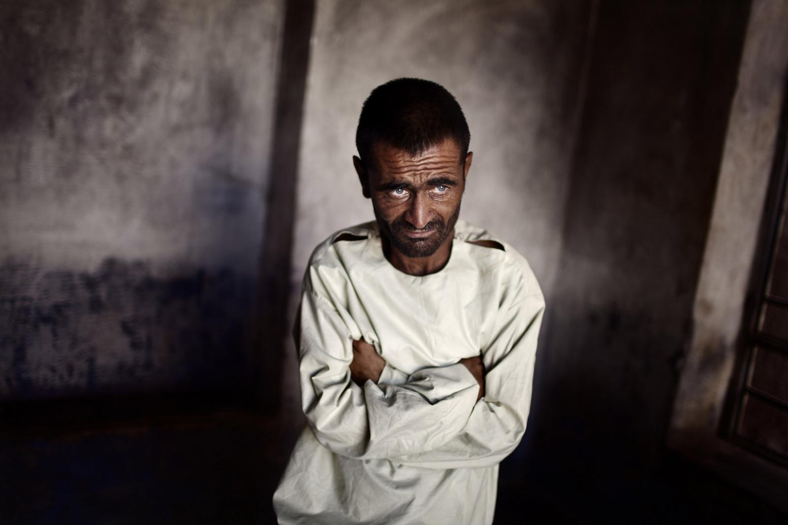 A mental patient lost in his thoughts in Herat, Afghanistan. July 26th, 2011. Diego Ibarra Sánchez / MeMo Population of Afghanistan has been exposed to sociopolitical instability, economic uncertainty, violence, and conflict for at least the past three decades