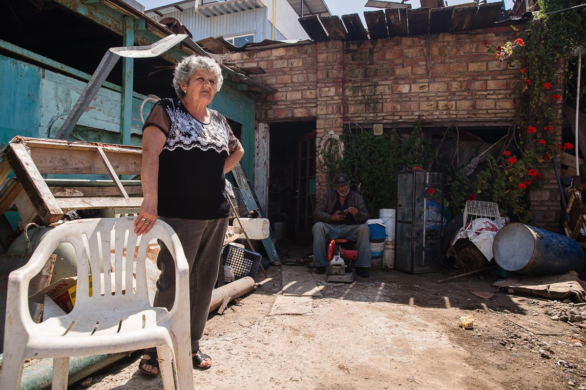 Marialena and her husband Ramon Ruvalcaba sit outside of their home in Puerto Nuevo, a community in Rosarito Beach Municipality in the Mexican state of Baja California on April 25, 2020.  Ramon says the Mexican government is not helping, there is no work and wonders how people will survive and support their families. He doesn't feel Coronavirus (COVID-19) is real and doesn't understand why there is no tourism.