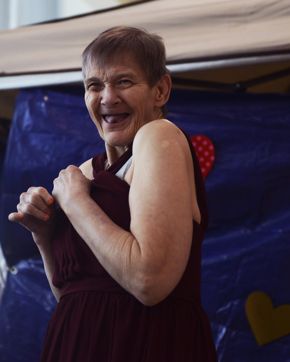 """Joyce Sims tries on a maroon gown at the """"Say Yes to the Dress"""" event on Saturday, Jan. 25, 2020, at the Activities and Recreation Center. Sims was overwhelmed with excitement and screamed in joy as she walked out of the changing room."""