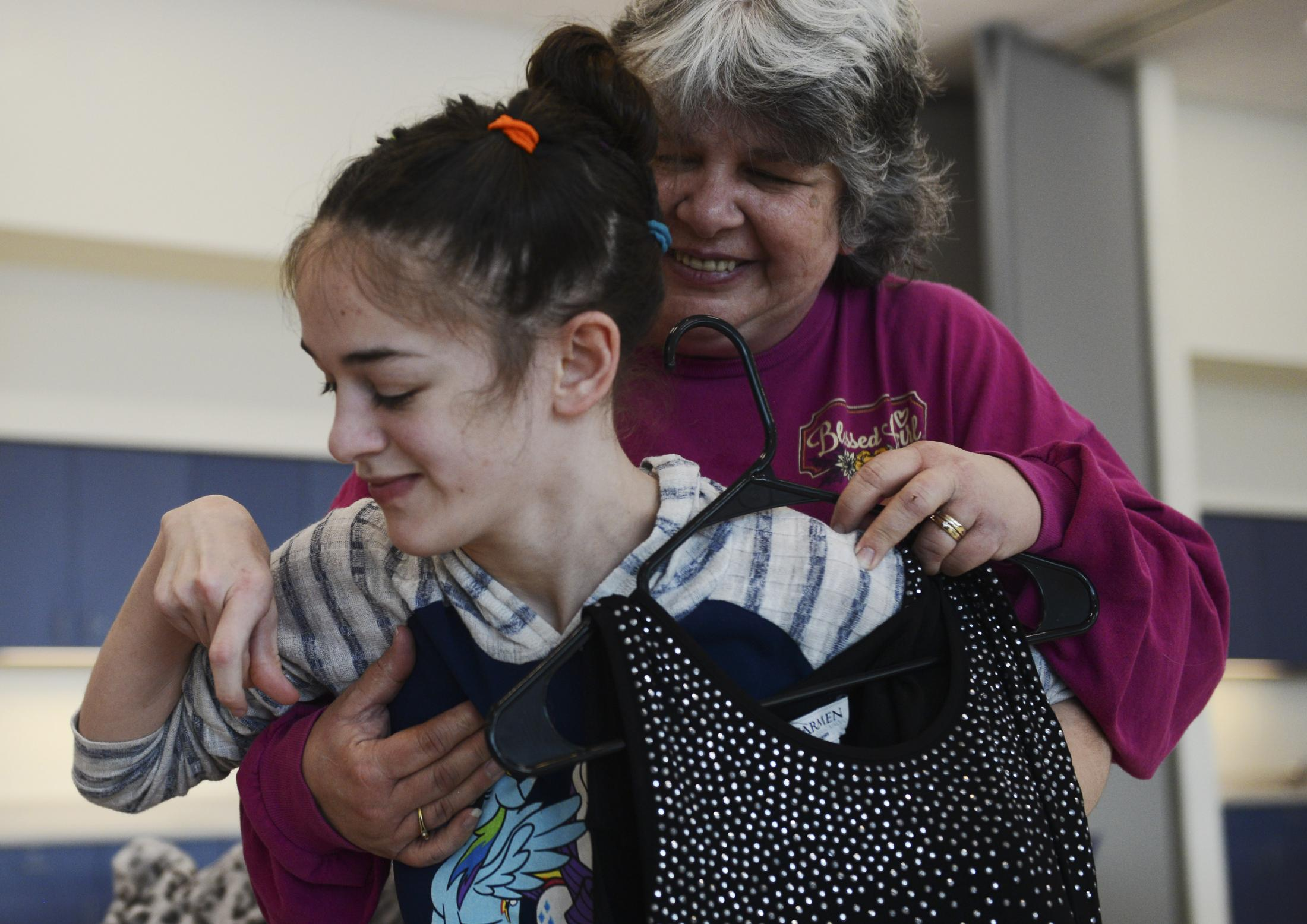Kathy Vanderslice, left, holds her daughter Betsy Vanderslice, 17, at the 'Say Yes to the Dress' event on Saturday, Jan. 25, 2020, at the Activities and Recreation Center. Betsy is unable to walk independently and has trouble trying on new clothes. But she knew this was her dream dress upon seeing it for the first time.