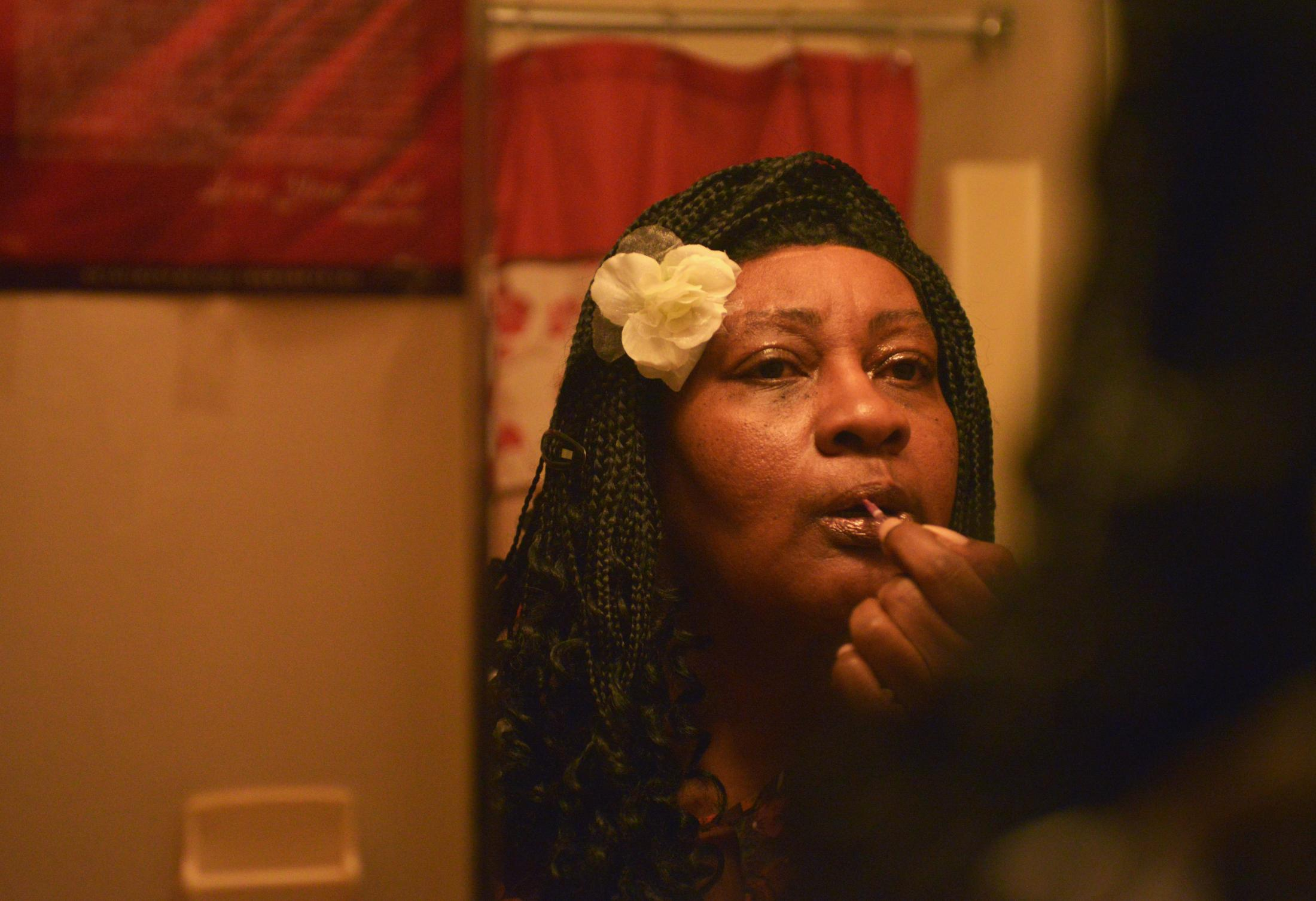 """Donna Fullington applies lipstick as she prepares for the Night to Shine dance Friday, Feb. 7, 2020, at her home in Fayette. Fullington has been looking forward to the dance all year. """"I have never been so nervous and excited as I am right now,"""" Fullington said."""