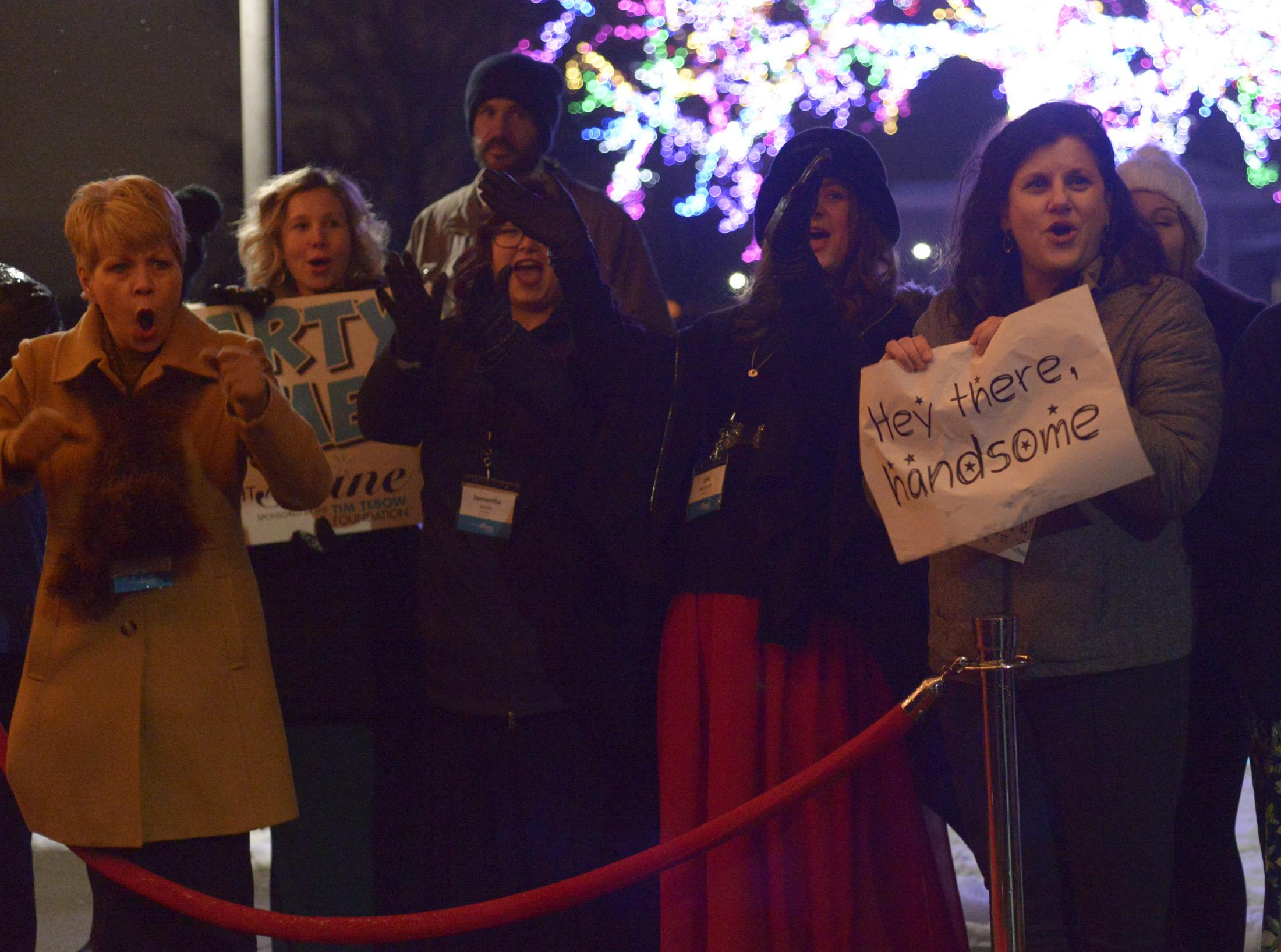 """A crowd cheers for the guests as they arrive at the red carpet Friday, Feb. 7 at the Night to Shine dance at The Crossing in Columbia. """"This night is for them,"""" paparazzi member Tricia Tonnies said. """"We want to make sure they feel as celebrated and special as they truly are."""""""