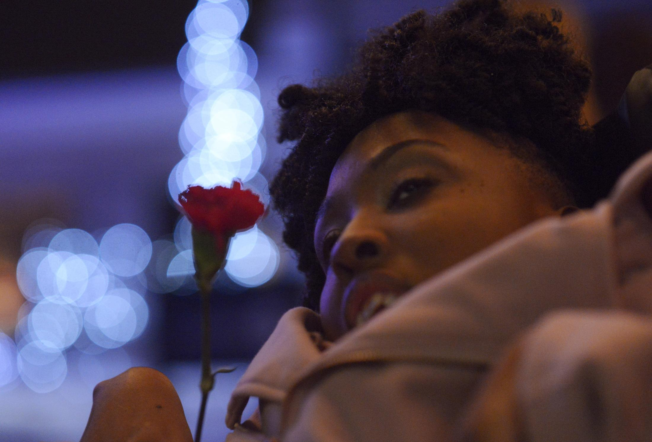 """Faith Jones arrives at the red carpet in a pink sequined dress carrying a red rose Friday, Feb. 7, 2020, at the Night to Shine dance at The Crossing in Columbia. She was escorted by Davonte Reedea. """"I have never seen her so happy and beautiful,"""" Reedea said."""