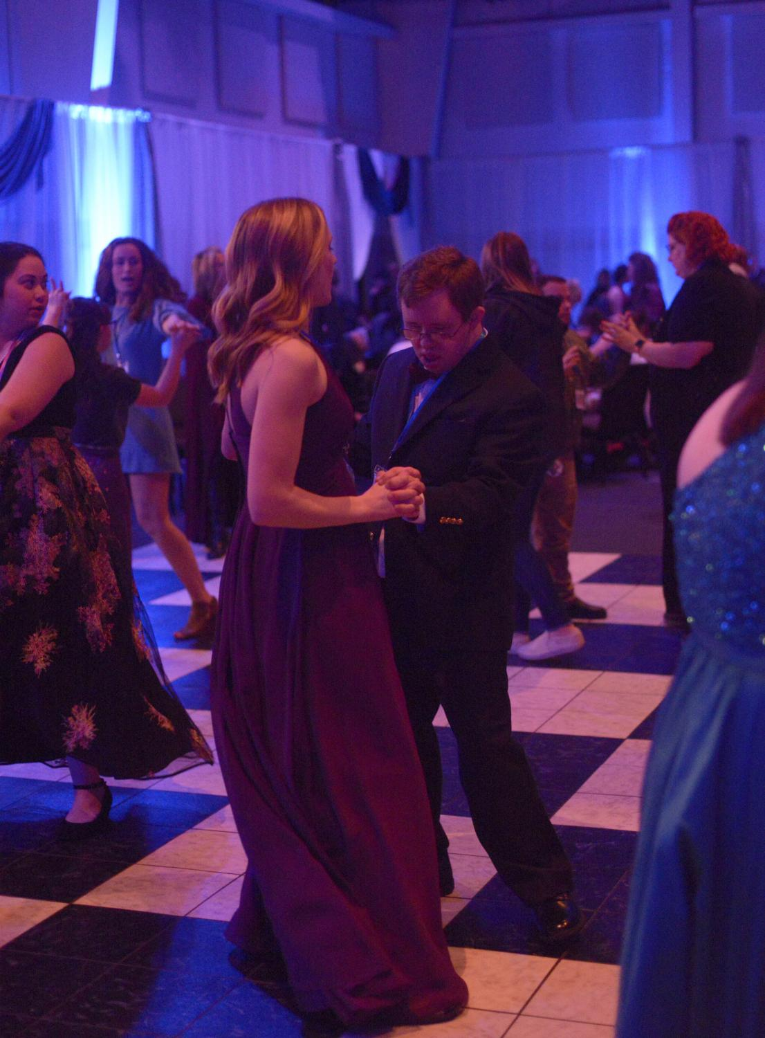"""Emily Chenoweth, left, and Christopher Mussatt dance Friday, Feb. 7, 2020, at the Night to Shine dance at The Crossing in Columbia. """"I got the moves,"""" Mussatt said."""