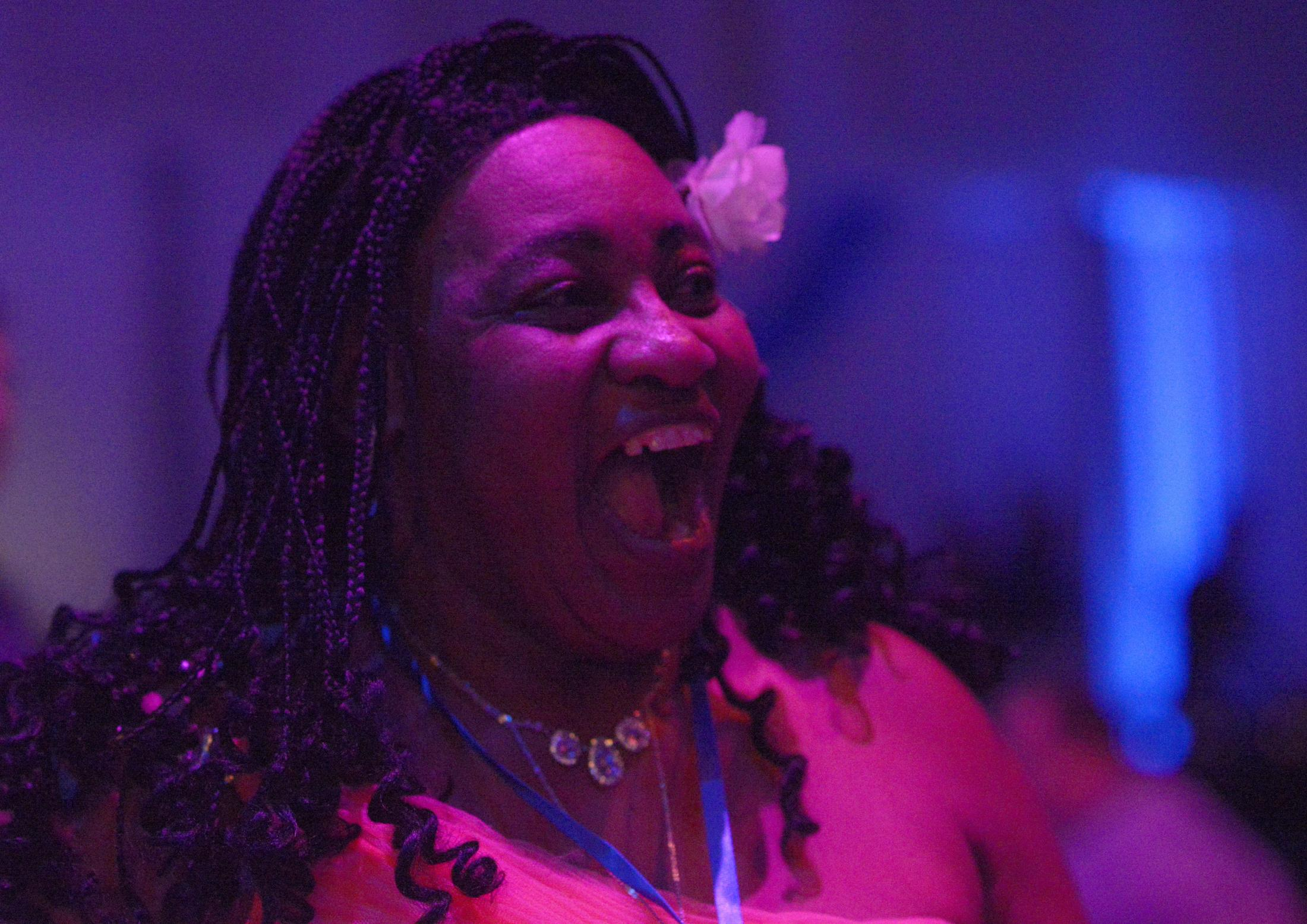 Donna Fullington smiles as she walks onto the dance floor Friday, Feb. 7, 2020, at the Night to Shine dance at The Crossing in Columbia. Fullington picked up the skirt of her peach gown and stepped onto the dance floor with confidence.