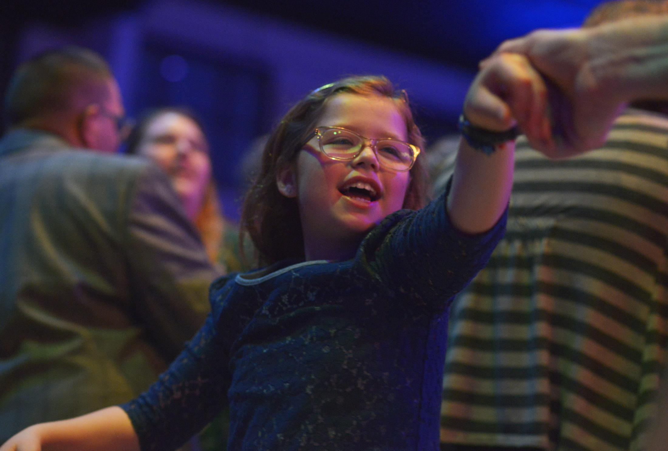 """Molly Wampler dances with her father Ryan Wampler on Friday, Feb. 7, 2020, at the Night To Shine dance at The Crossing in Columbia. Molly belted the hit Frozen song """"Let It Go"""" as her father spun her around the dance floor."""
