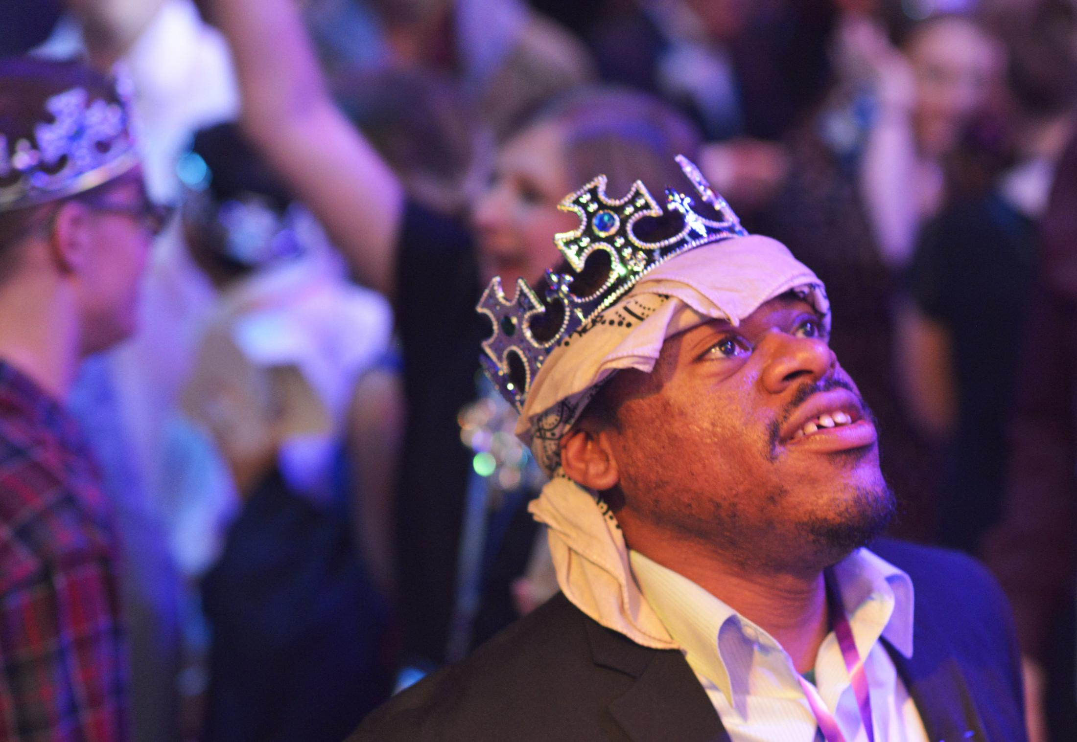 """Gary Jackson looks to the light show in awe after being crowned one of the prom kings Friday at the Night to Shine dance at The Crossing in Columbia. """"I am the king,"""" Jackson said. """"Now I just need to find my queen."""""""