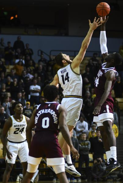 Missouri's Reed Nikko and Mississippi State's Abdul Ado jump for the tip-off on Saturday, Feb. 29, 2020, at Mizzou Arena. Missouri lost 63-67.