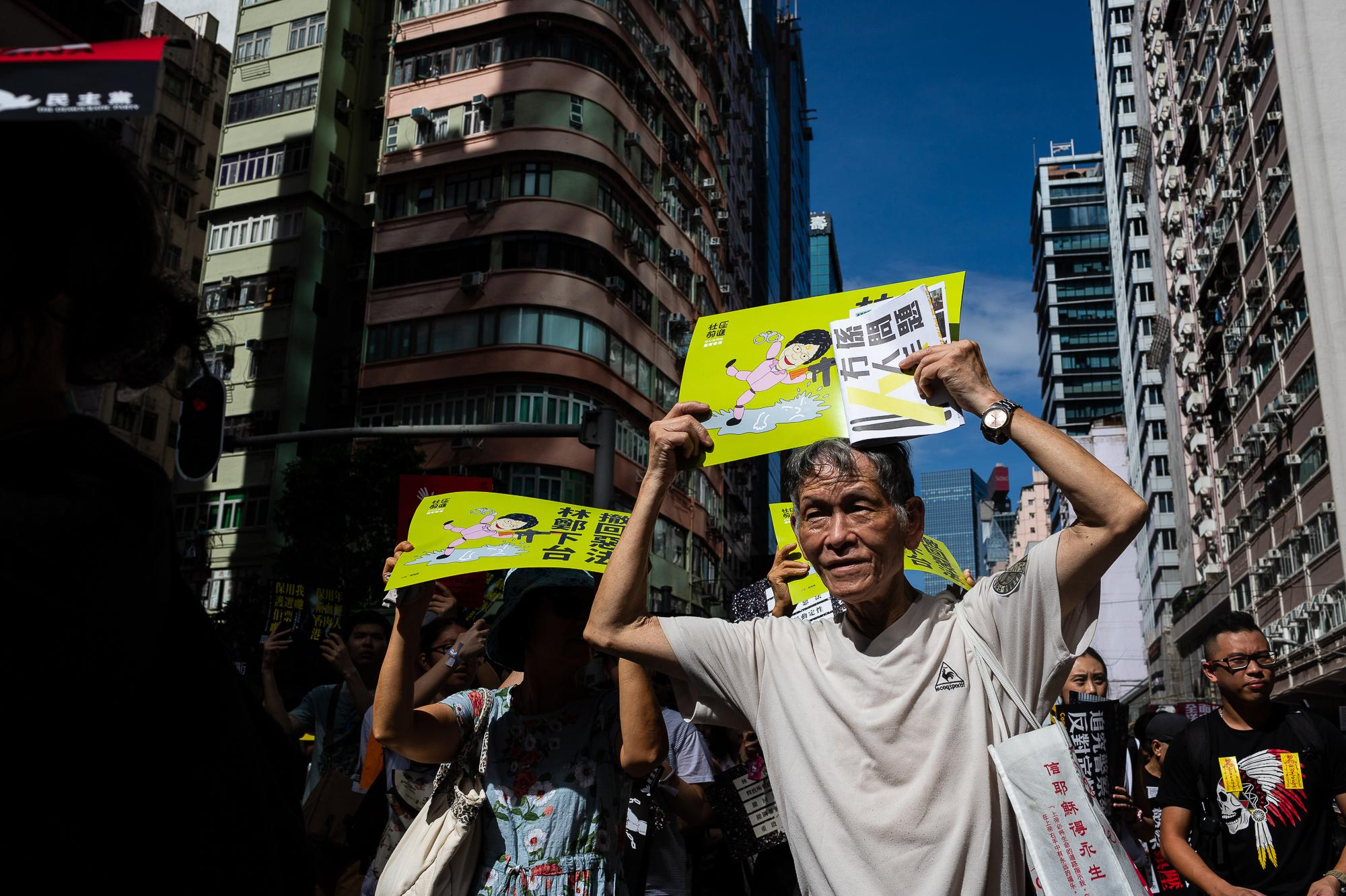 Protestors hold banners while marching during the demonstration to mark the 22nd anniversary of the handover of the territory in Hong Kong.