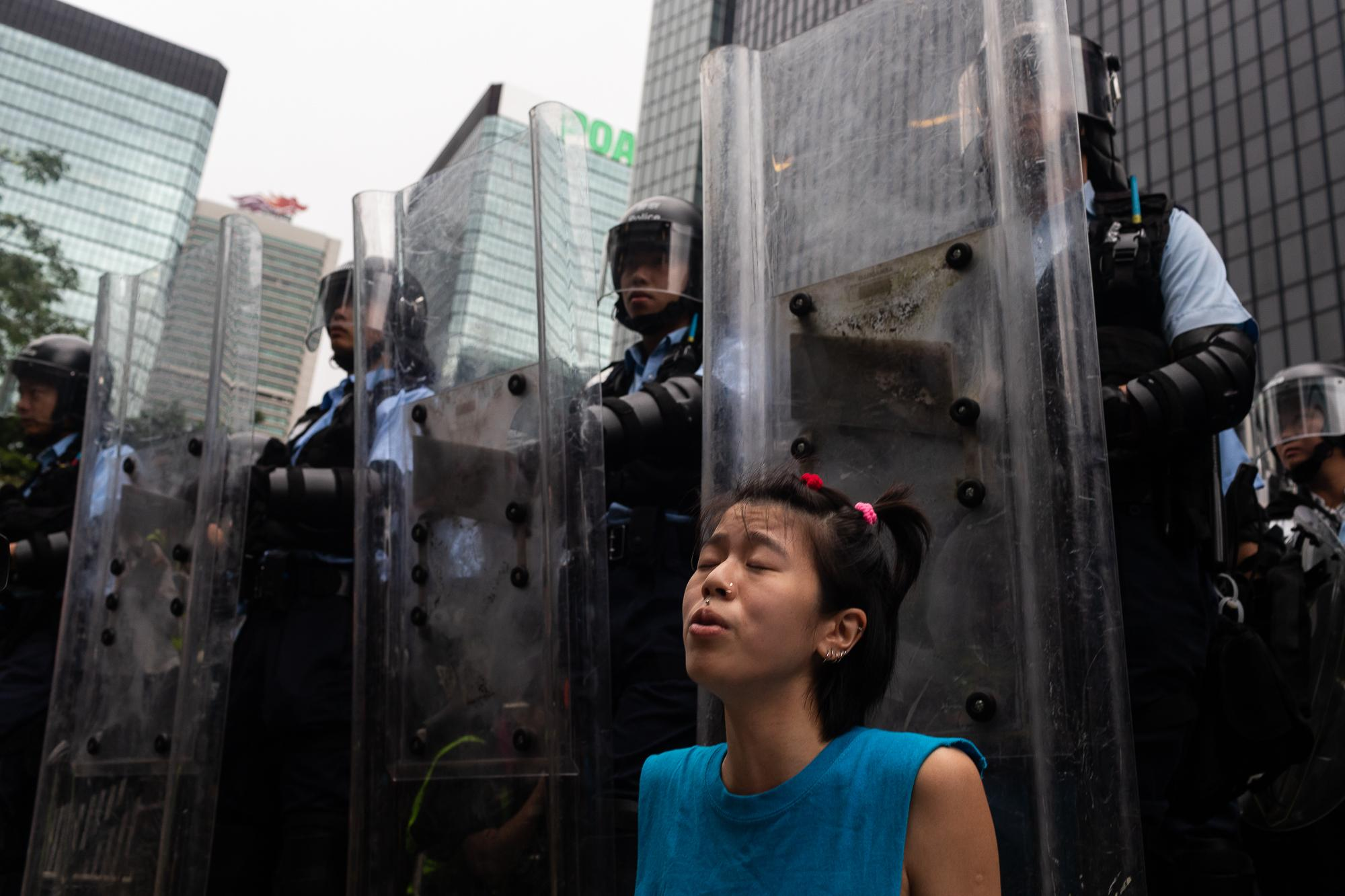 A demonstrator sits-in in front of the legislative council during a protest against a proposed extradition law in Hong Kong. Protesters blocking major roads in downtown Hong Kong vowed to stay until the government withdraws controversial legislation that would for the first time allow extraditions to China.