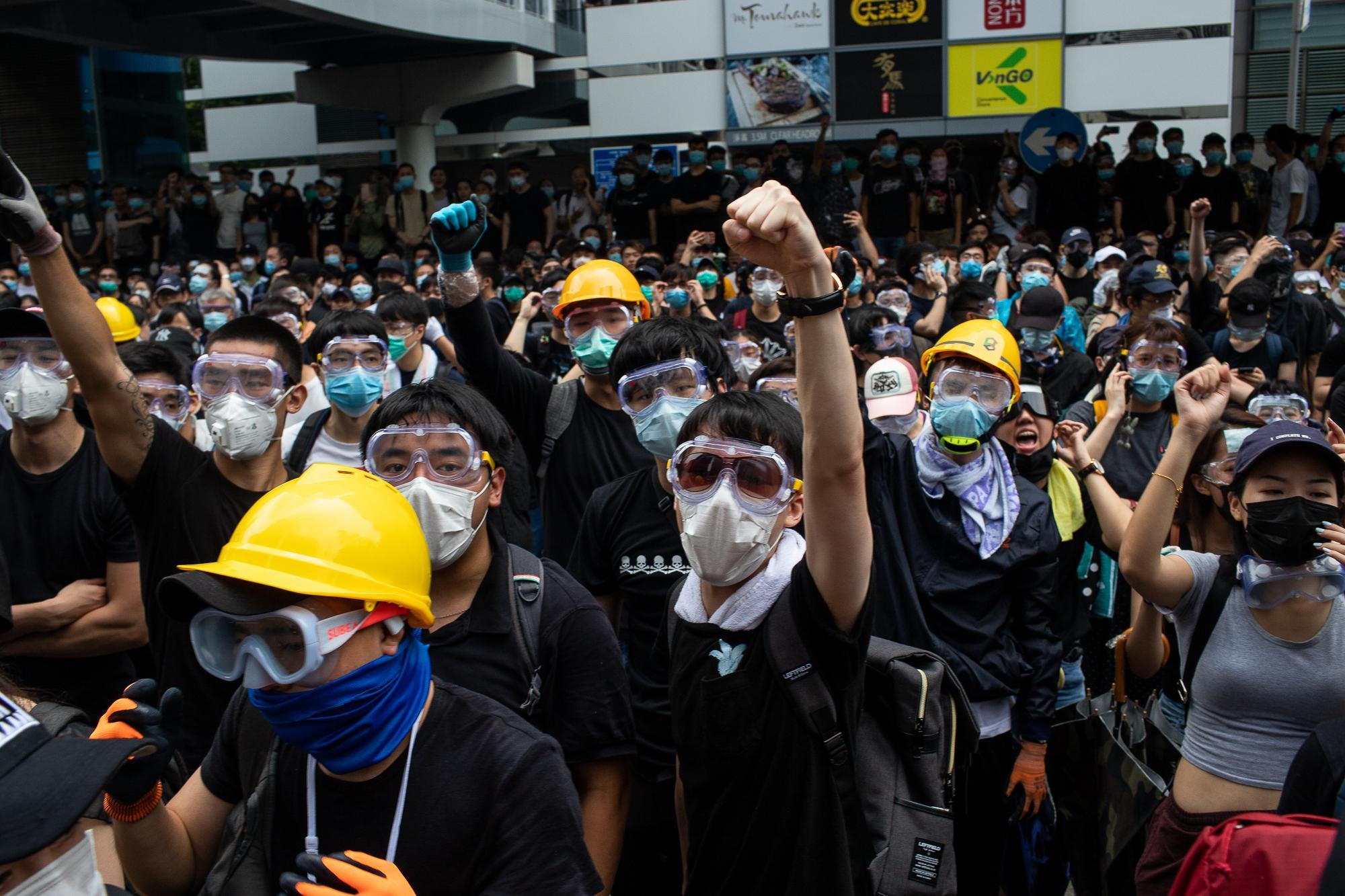 Demonstrators protest outside the legislative council in Hong Kong.