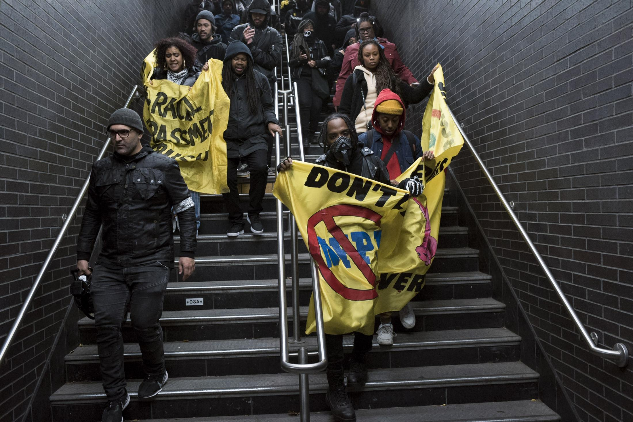 "A group of protesters make their entry to the Hoyt station in downtown, Brooklyn. The ""emergency action"", organized by the activist group 'Decolonize This Place', comes in response to the MTA's efforts to stop fare-beating, which have led to the deployment of 500 new subway cops across the transit system, among other deterrence measures. Brooklyn, NY. November 2019"