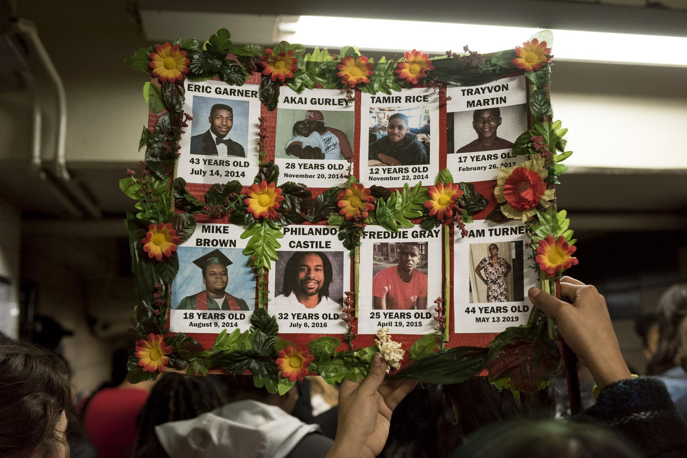 A sign shows the portraits that remember victims of police brutalities in NYC. All of them are black or Latinos. Brooklyn. Brooklyn, NY. November 2019