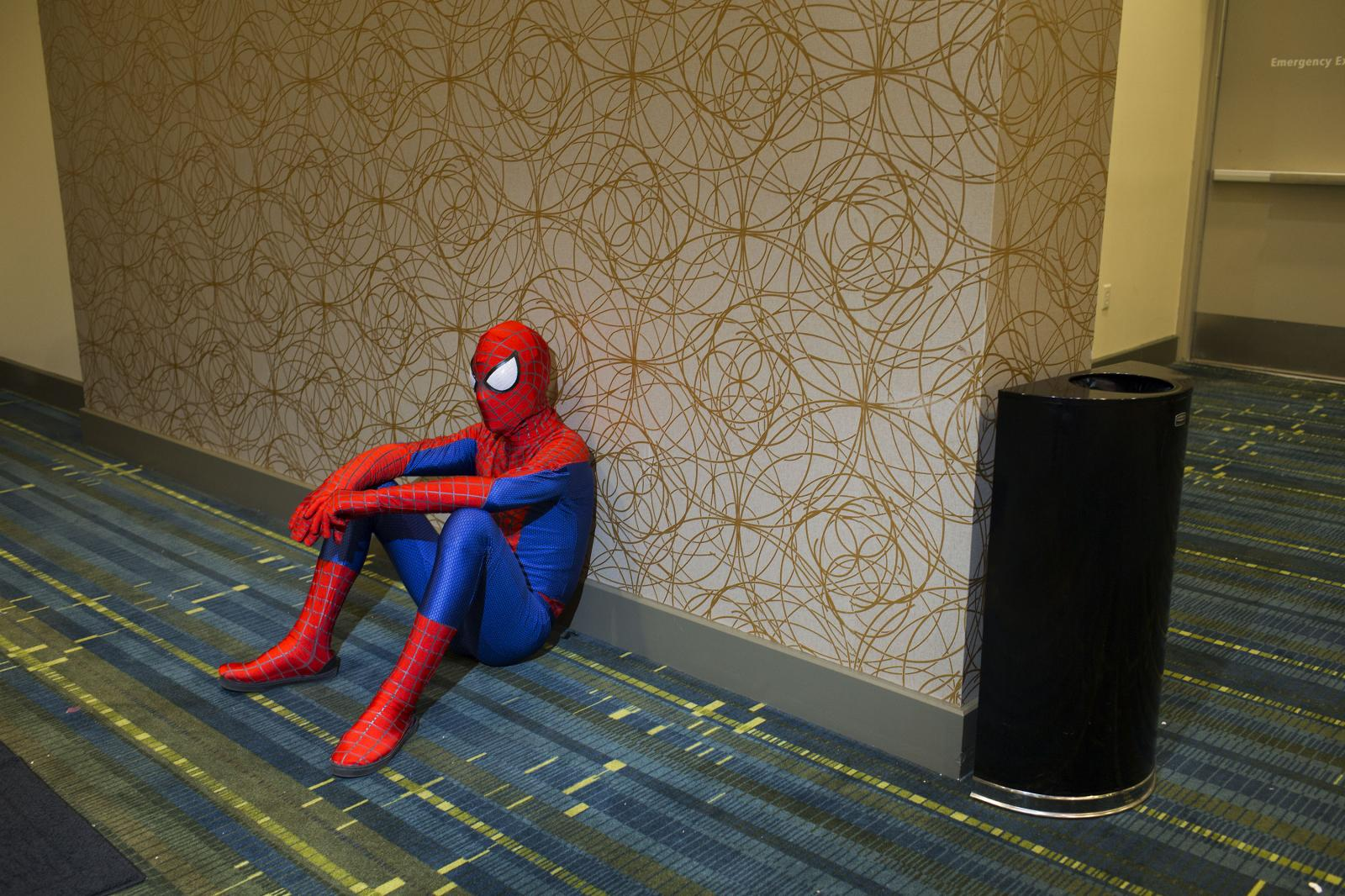 Dan Locklin of Cedar Rapids, dressed as Spiderman, takes a break during Cedar Rapids Comic Con at the Cedar Rapids DoubleTree Hotel & Convention Center on Saturday, February 3, 2018. Locklin is part of CRUSH, or Cedar Rapids Ultimate Super Heroes, a group offering free photos with suggested donations benefiting the Cedar Valley Humane Society. KC McGinnis / The Gazette
