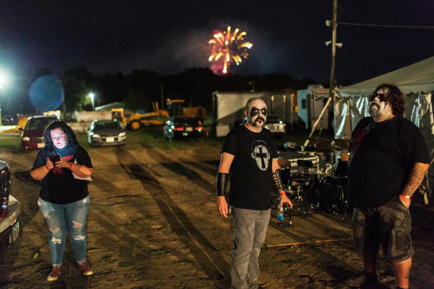 A Christian metal band gets ready to perform while fireworks go off in the background at Audiofeed Festival in Urbana, Illinois on Sunday, July 2, 2017. © 2017 KC McGinnis
