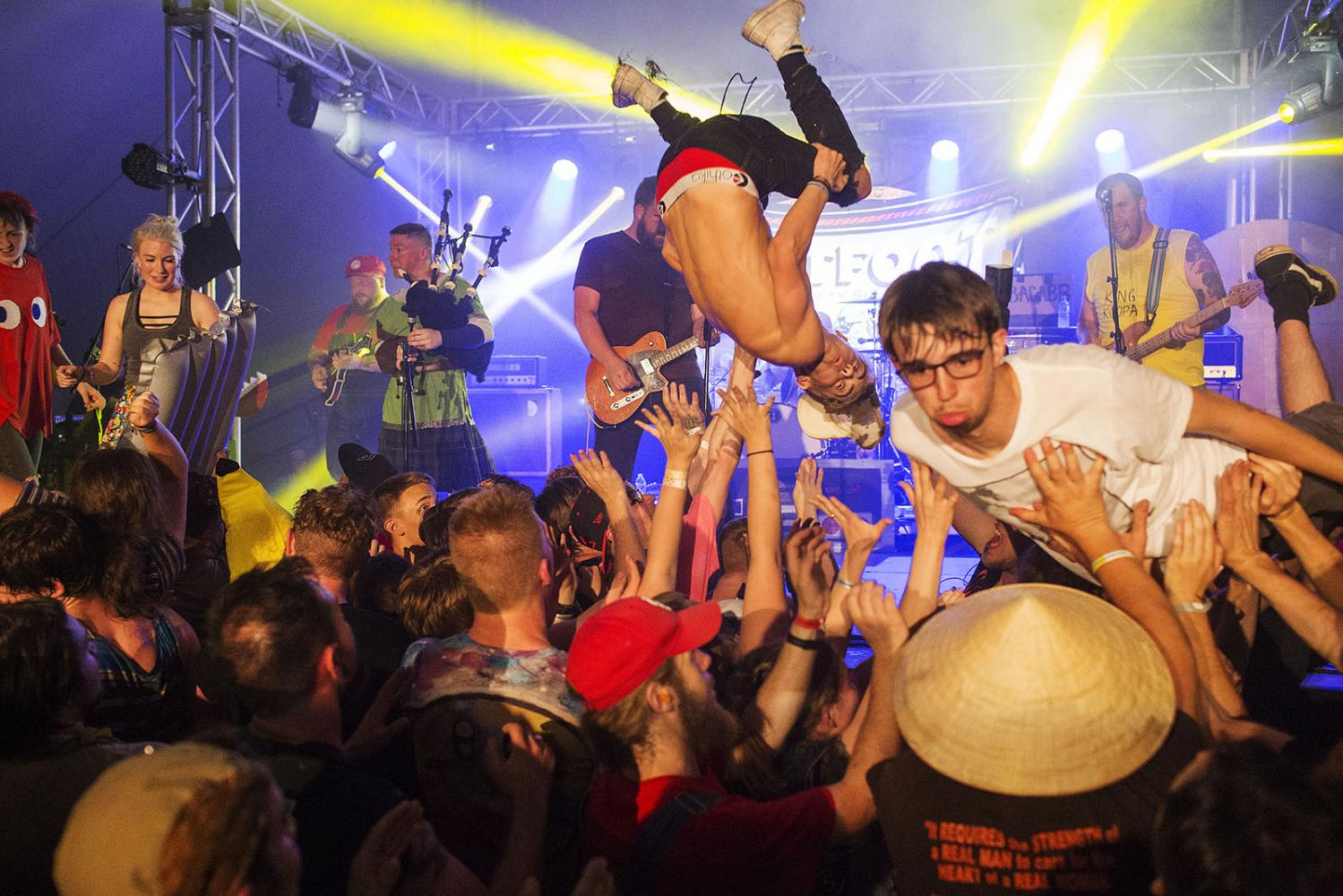 Fans crowd surf to Irish punk band Flatfoot 56 at Audiofeed Festival in Urbana, Illinois on Sunday, July 2, 2017. © 2017 KC McGinnis