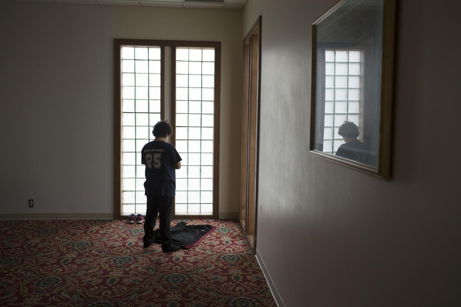 12-year-old Baraa Sadok of Cedar Rapids prays in a separate room during Friday prayers at the Islamic Center of Cedar Rapids in Cedar Rapids, Iowa on Friday, January 20, 2017. KC McGinnis for Rolling Stone