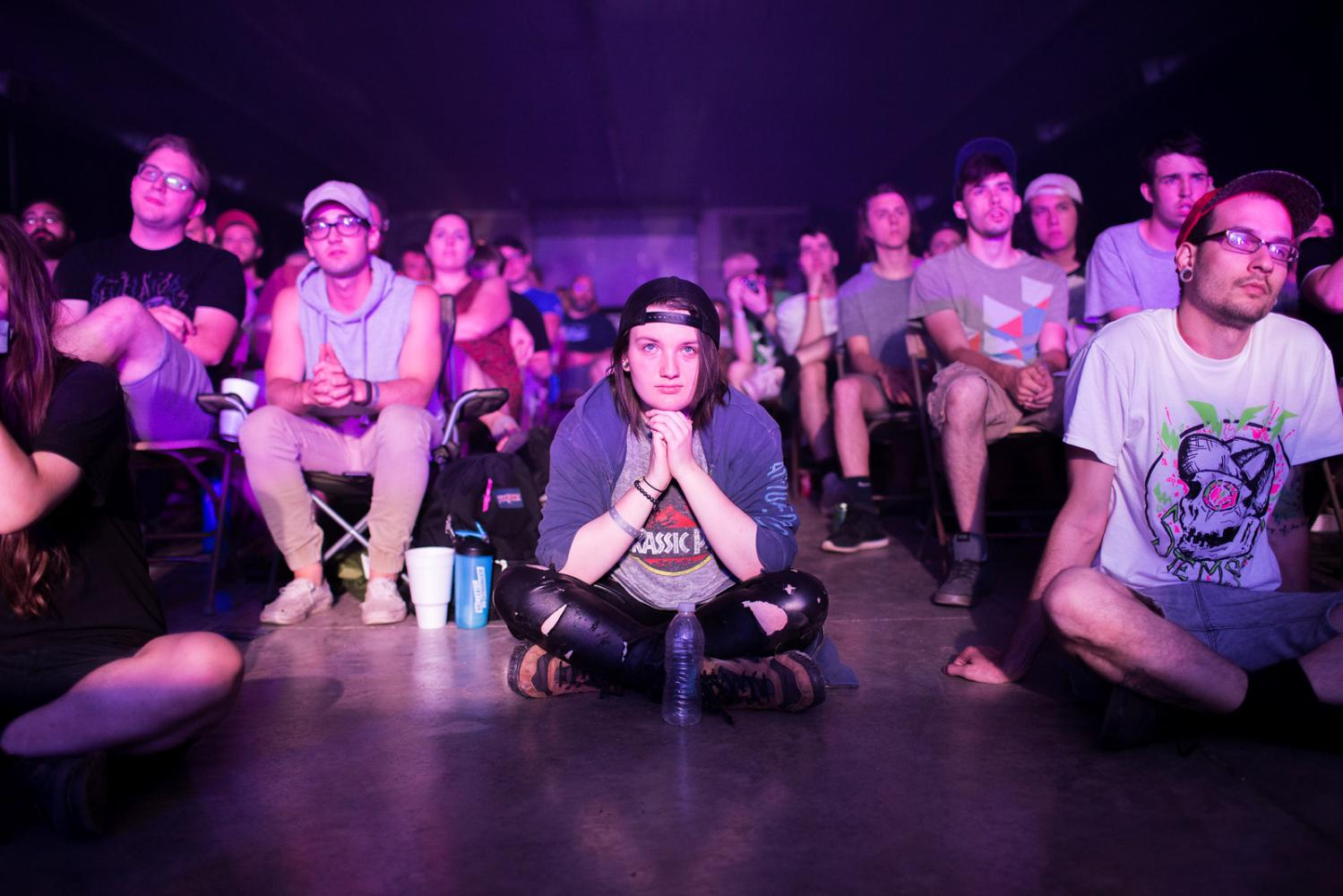 Landon Zettelmier from Champaign, Ill. watches as Dave Bazan performs at Audiofeed Festival in Urbana, Illinois on Saturday, July 1, 2017. Zettelmier said they came to Christ in a mosh pit at Audiofeed festival in 2015, and came out as transgender at Audiofeed in 2016. © 2017 KC McGinnis