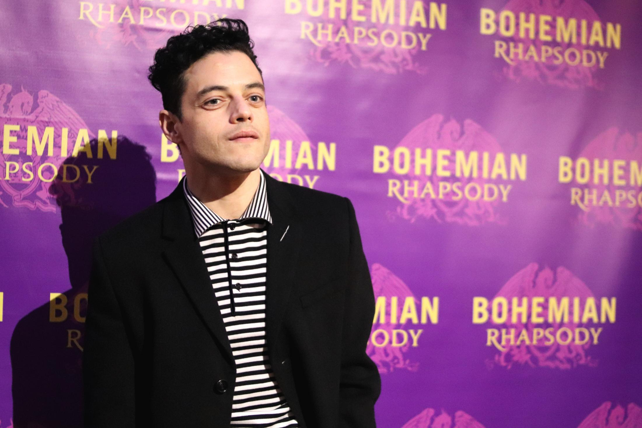 Rami Malek arrives at the red carpet for the Boston premiere of Bohemian Rhapsody.