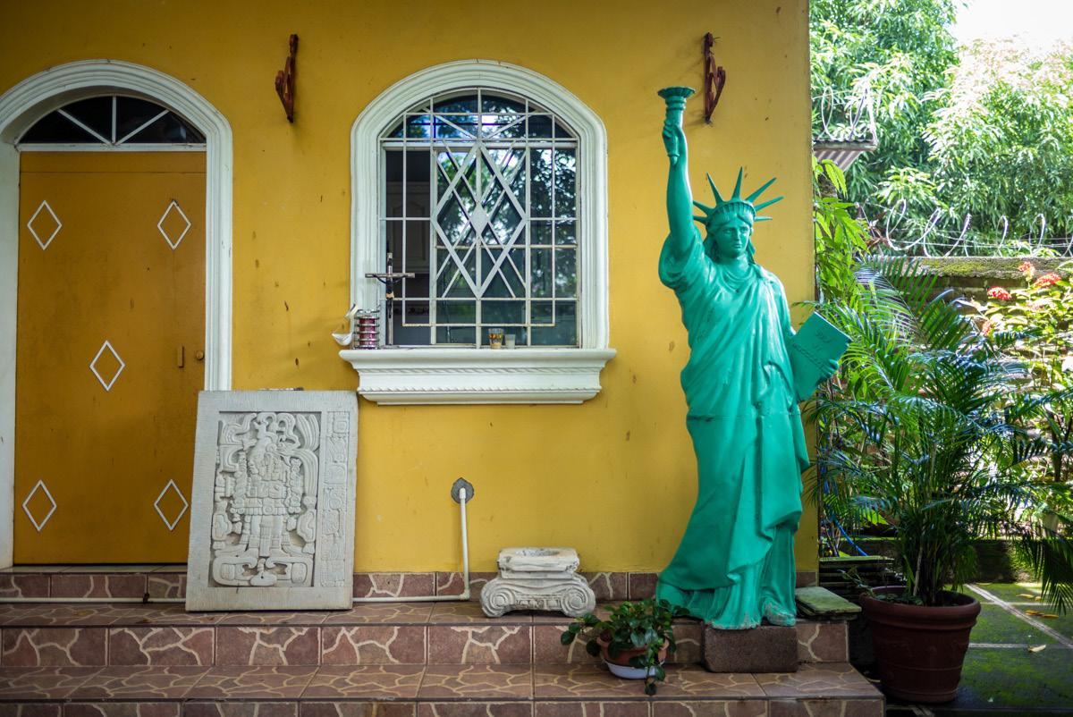 At Hugo Salinas and his uncle Alcides Andrade house. The liberty statue has been brought from the US. El Salvador, Intipuca - September 2019.