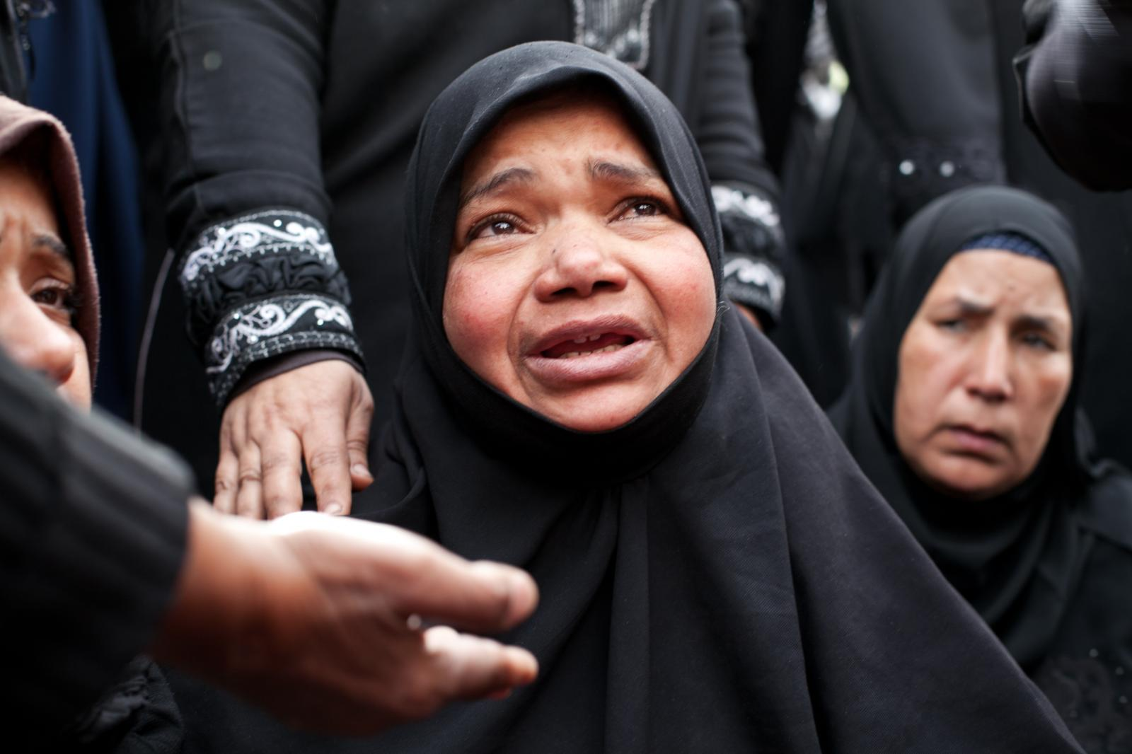 Women mourn for their relative, Ahmed Abdul Khalim, 24, who was killed with a bullet to his head during recent clashes with Egyptian security forces in Port Said, Egypt, Friday, March 8, 2013. Egypt's police forces have withdrawn from the streets of this restive city on the Suez Canal, handing over security to the military after nearly a week of deadly clashes.