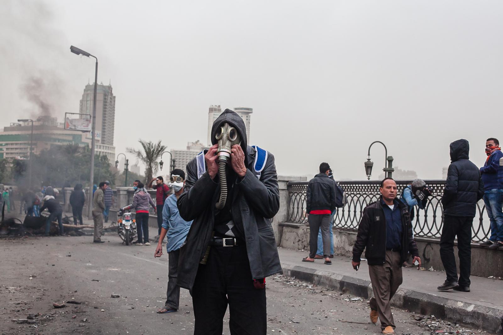 Security forces fire tear gas at protesters who threw rocks back near Tahrir Square in Cairo on January 28, 2013. Violence erupted on January 25th, the second anniversary of the uprising that toppled longtime ruler Hosni Mubarak. Egypt's main opposition rejected president, Mohamed Morsi's call for dialogue unless their conditions were met.