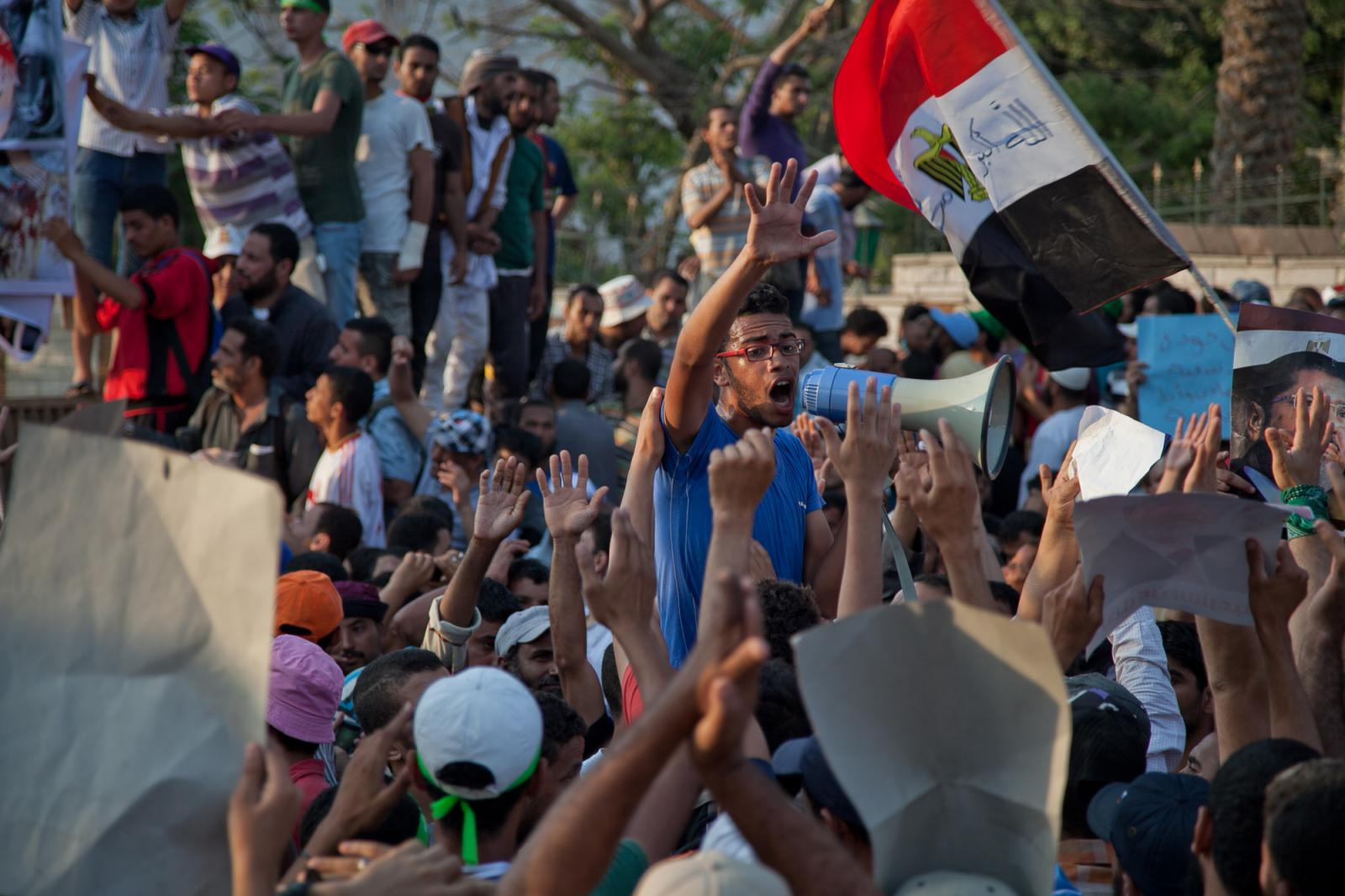 A day after a massacre on July 9, 2013 that killed 51 people and left hundreds injured. Pro-Morsi supporters continue to gather at the Republican Guard in Cairo, Egypt. Hundreds march towards the military.