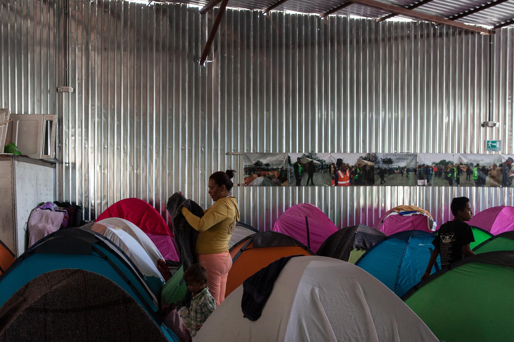 The Juventud 2000 migrant shelter located on the edge of Tijuana's red-light district is filled with colorful tents to accommodate about   200 arrivals.  People start to wake up on April 25, 2018.