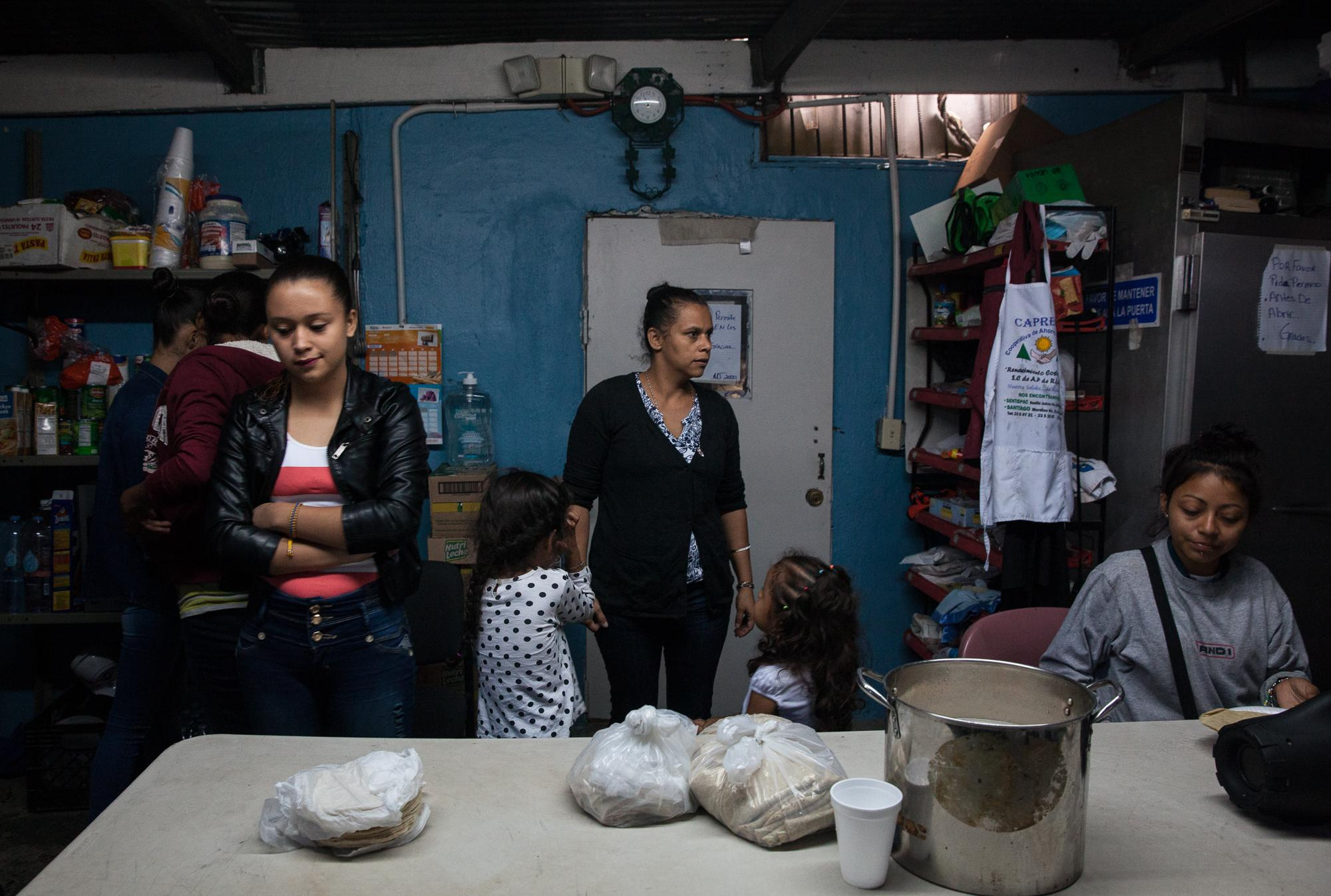 Women and children from Central America in the kitchen at Juventud 2000 shelter in Tijuana, Mexico on April 25, 2018.