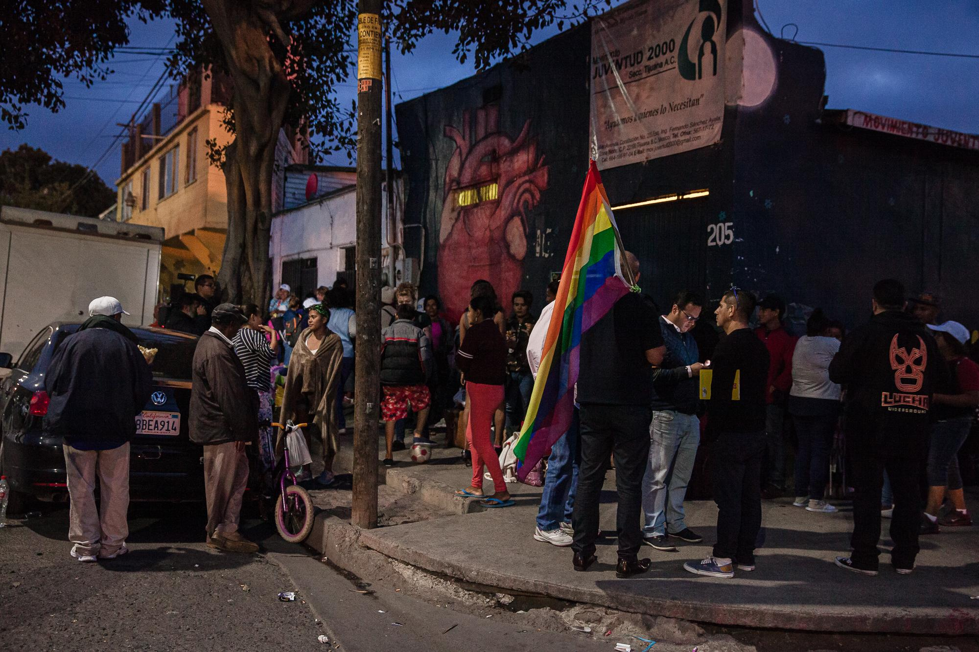 A small group of LGBTQ supporters showed up before the 4th bus arrived to show solidarity. After the bus arrived people stood outside of Juventud 2000 shelter in Tijuana, MX, on April 26, 2018.