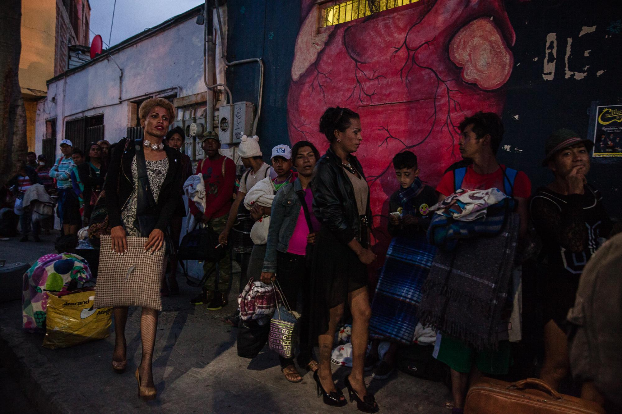 Fourth bus arrives in front of Juventud 2000 shelter in Tijuana, MX, on April 26, 2018. More than 30 LGBTQ people traveled with the caravan including several trans women.